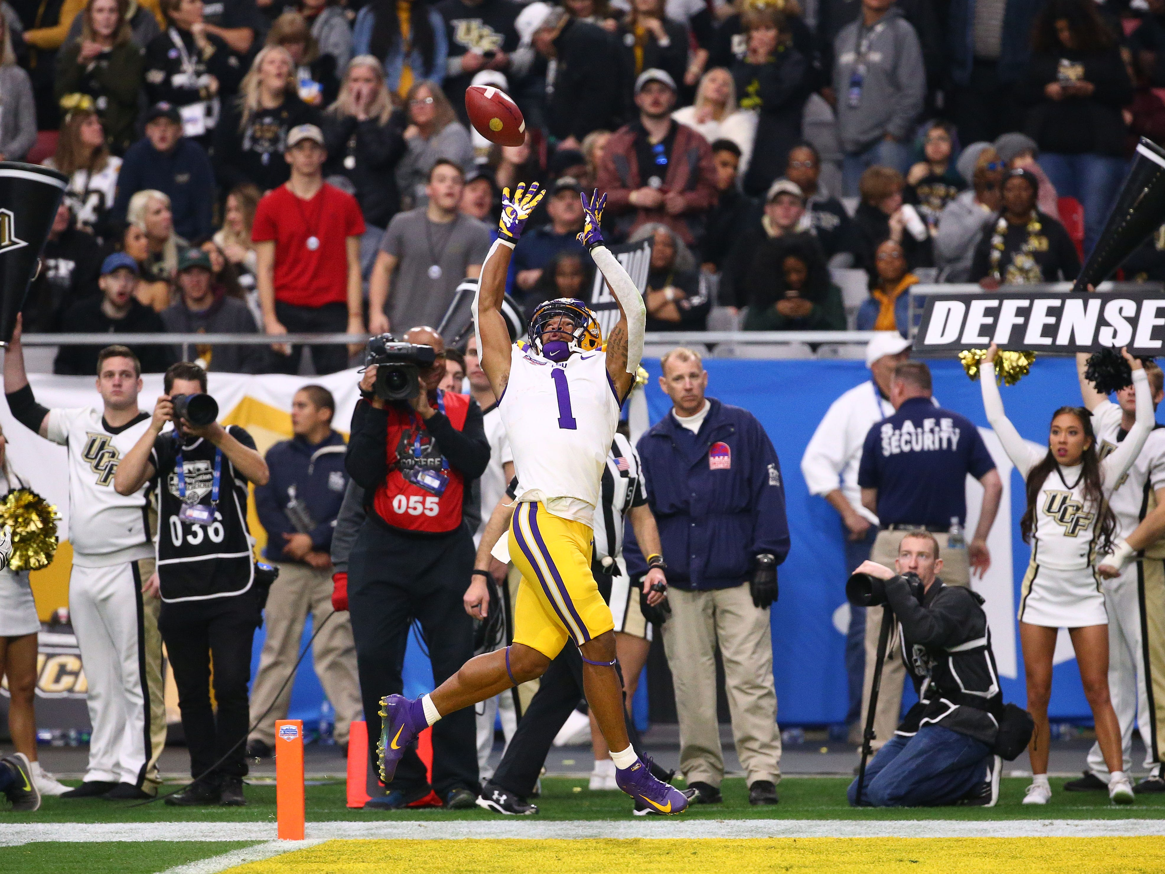 LSU Tigers wide receiver Ja'Marr Chase (1) makes a touchdown catch against the UCF Knights in the second half at the Fiesta Bowl on Jan. 1 at State Farm Stadium.