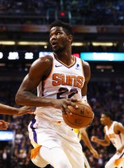 Dec 31, 2018; Phoenix, AZ, USA; Phoenix Suns center Deandre Ayron (22) against the Golden State Warriors in the first half at Talking Stick Resort Arena. Mandatory Credit: Mark J. Rebilas-USA TODAY Sports