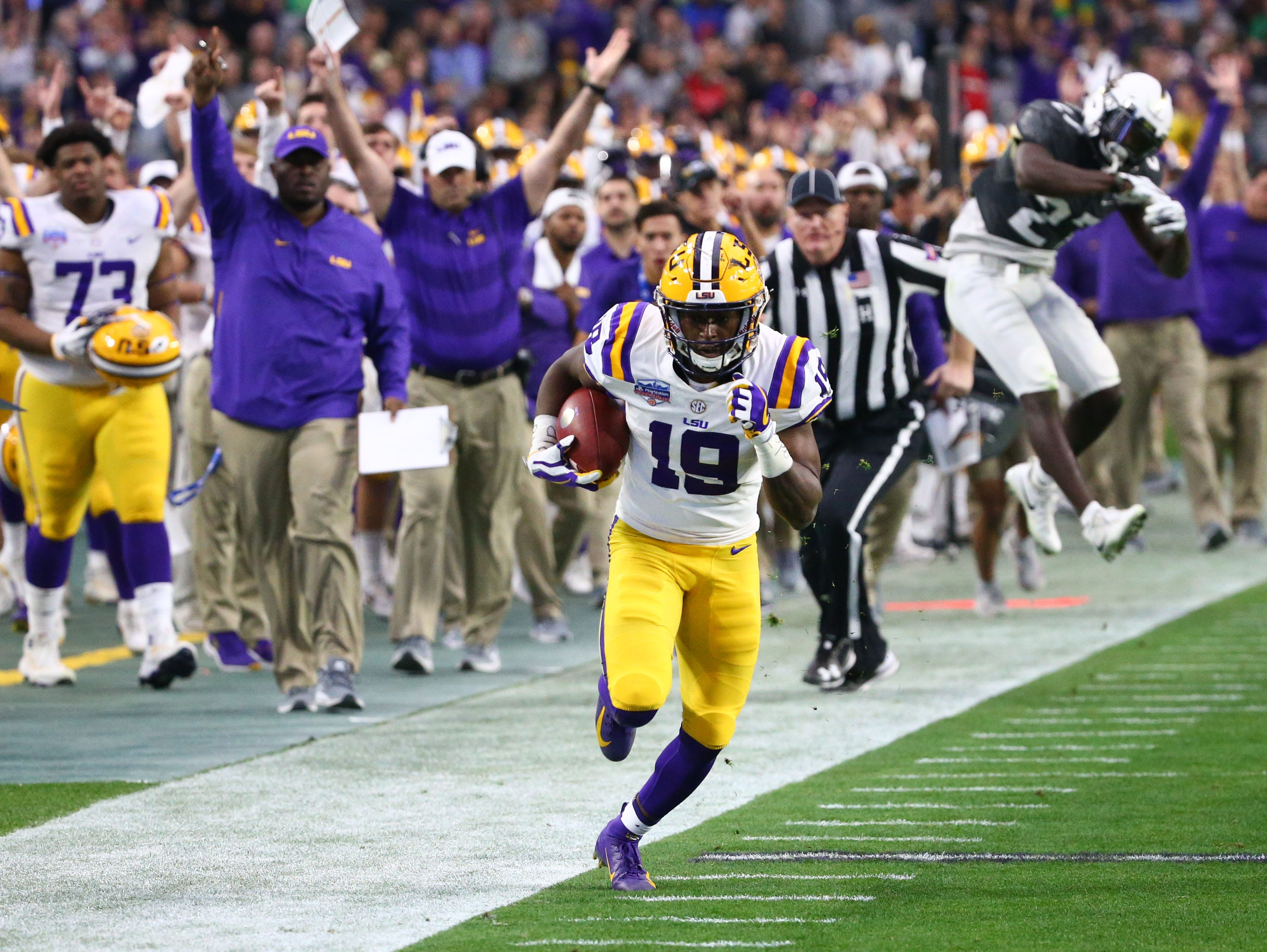 LSU Tigers wide receiver Derrick Dillon (19) runs for a touchdown against the UCF Knight in the first half at the Fiesta Bowl on Jan. 1 at State Farm Stadium.