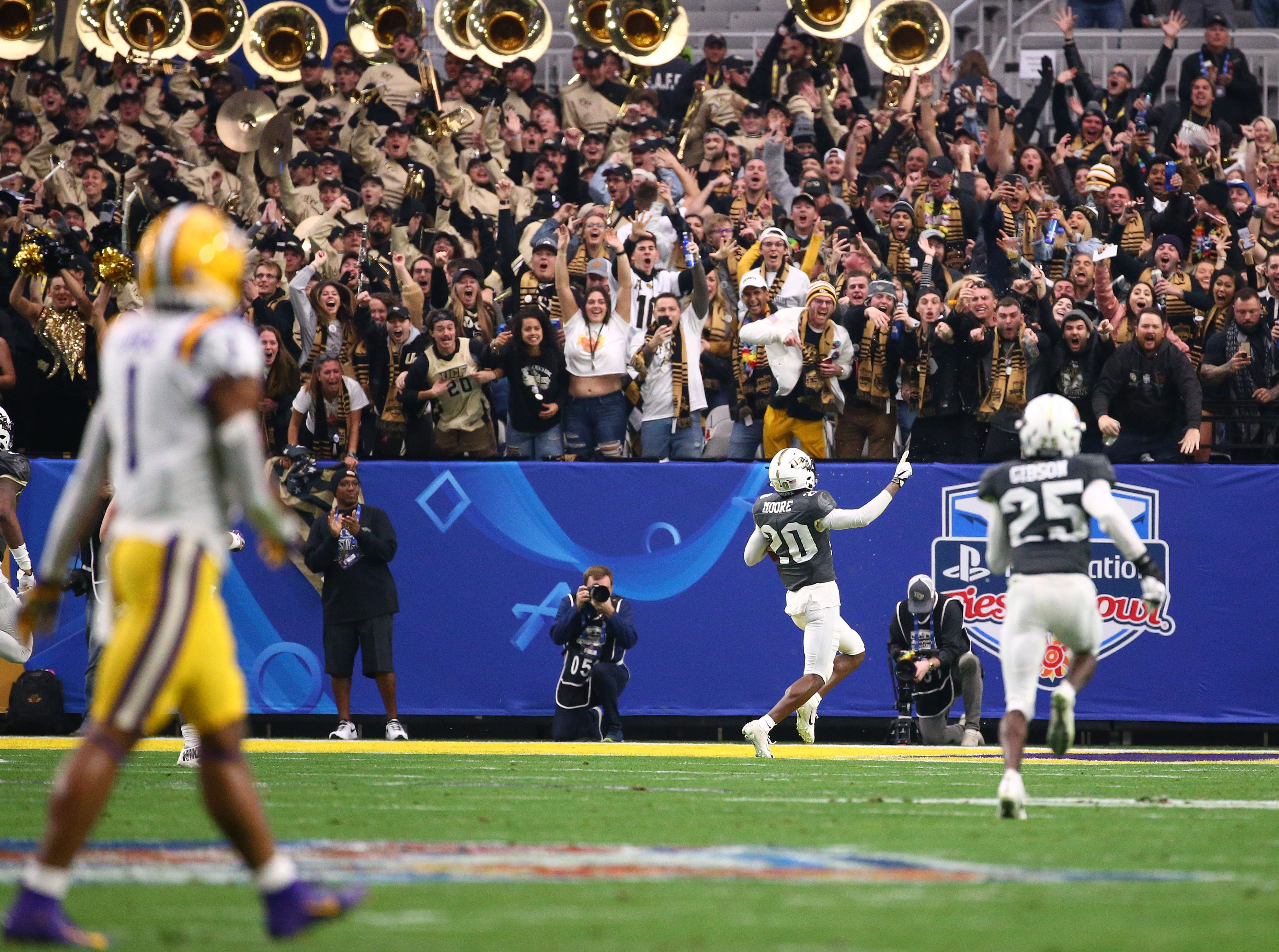 UCF Knights defensive back Brandon Moore scores a touchdown on a interception against the LSU Tigers in the first half at the Fiesta Bowl on Jan. 1 at State Farm Stadium.