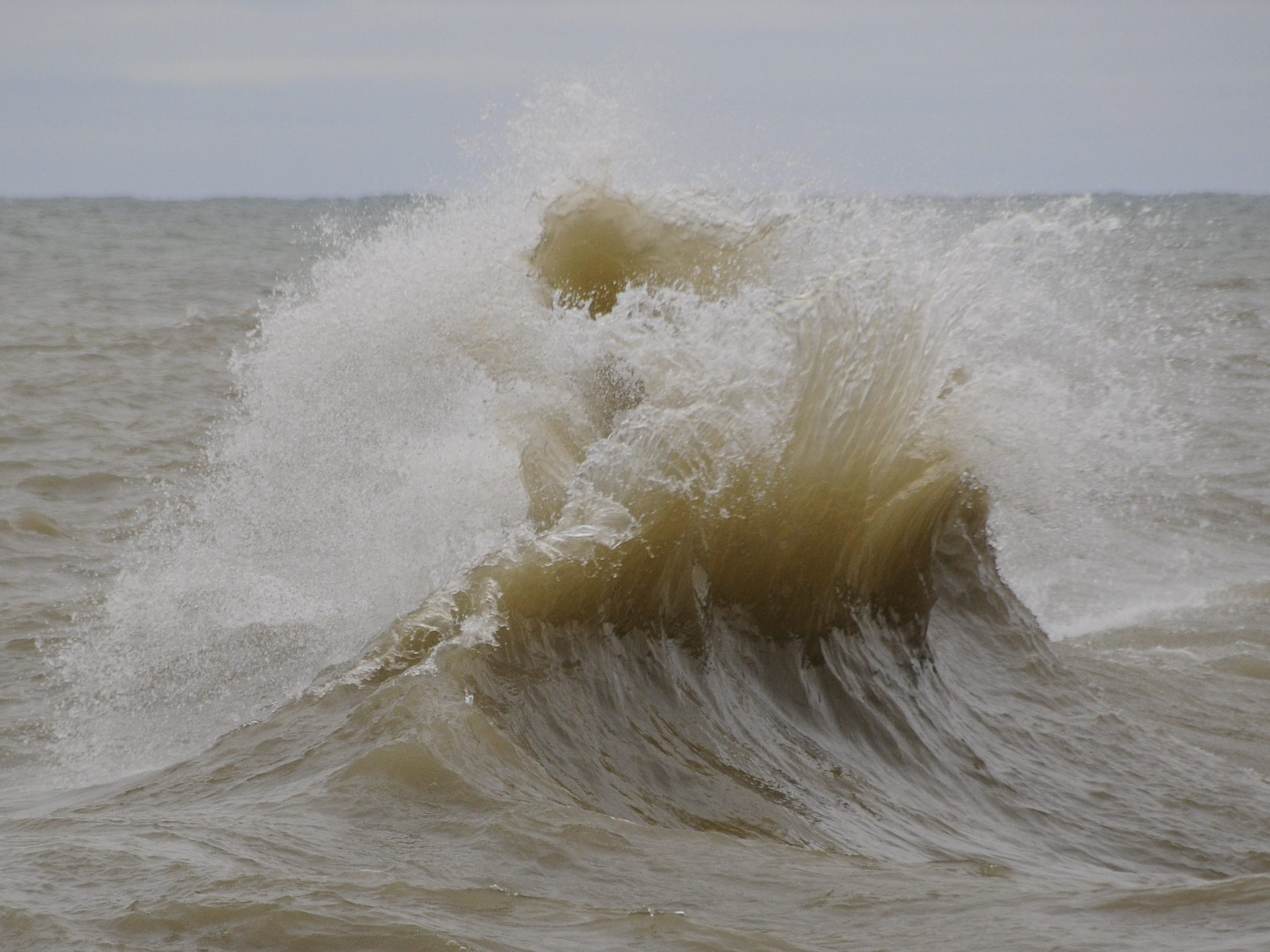 Waves collide in Port Sanilac on New Year's Day 2019.