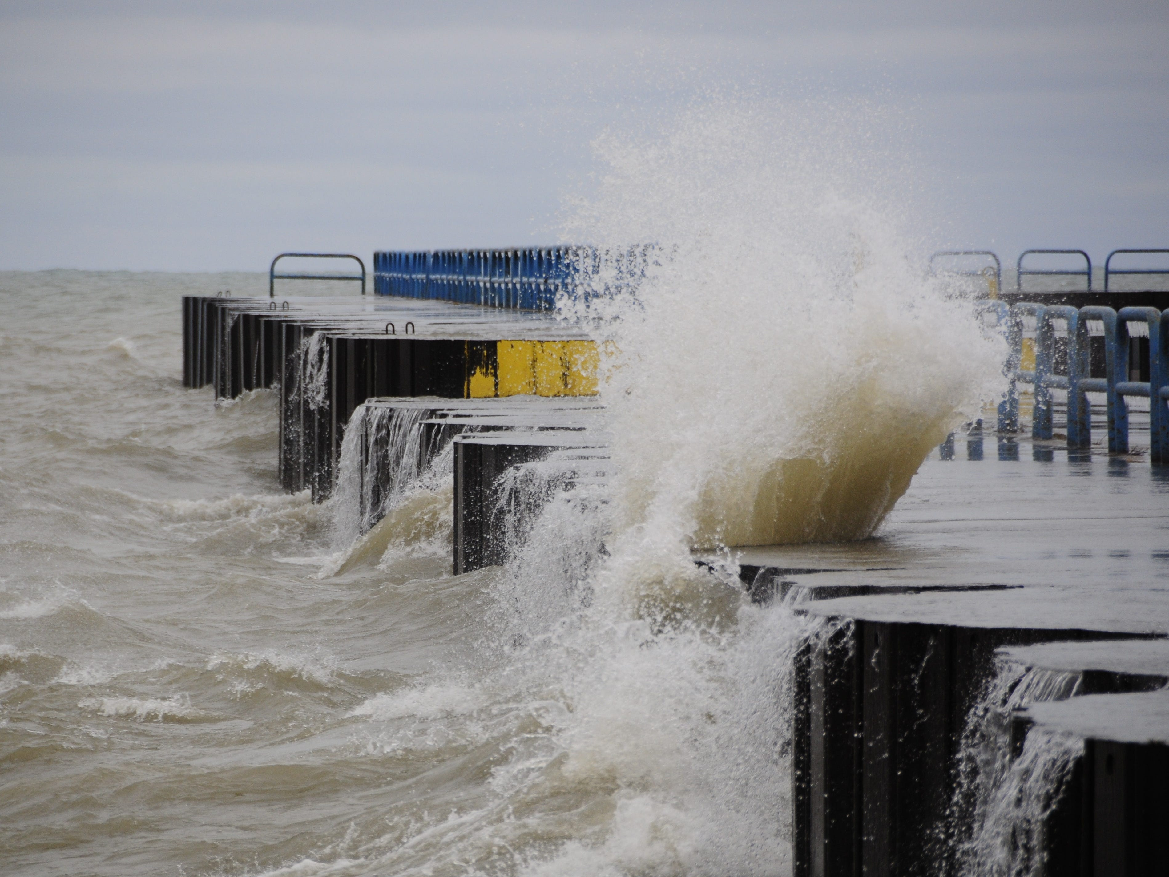 A wave smashes into the north breakwall in Port Sanilac on New Year's Day 2019.