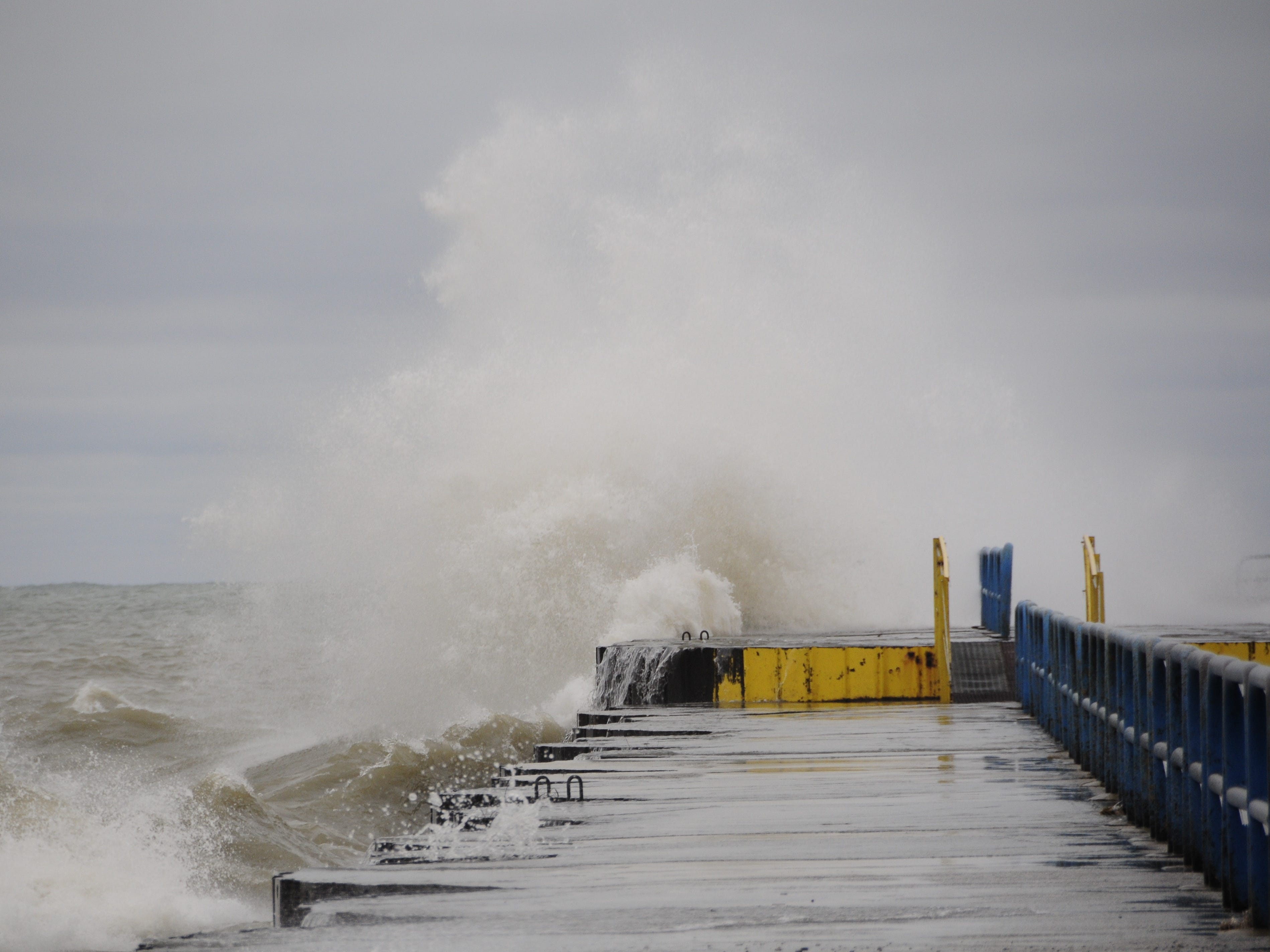 A large wave slams into the north breakwall in Port Sanilac on New Year's Day 2019