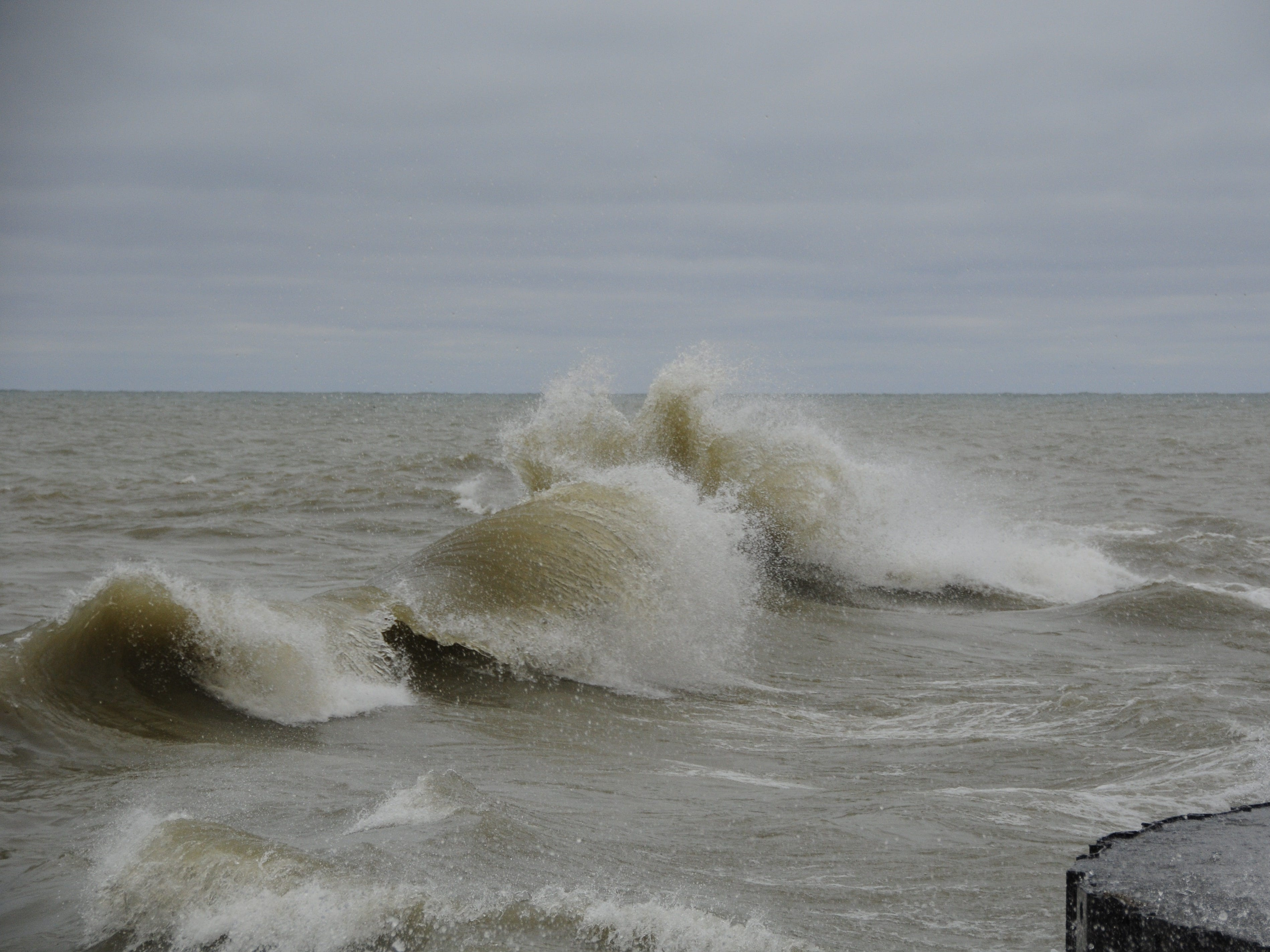 Waves boil ashore in Lake Huron near Port Sanilac on New Year's Day 2019.