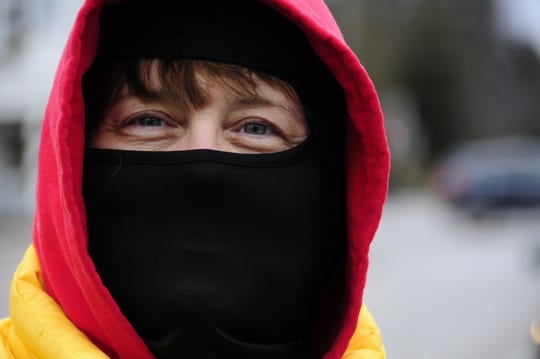 LuAnn Crawford bundles up to ride in the Lexington to Croswell New Year's Bike Ride.