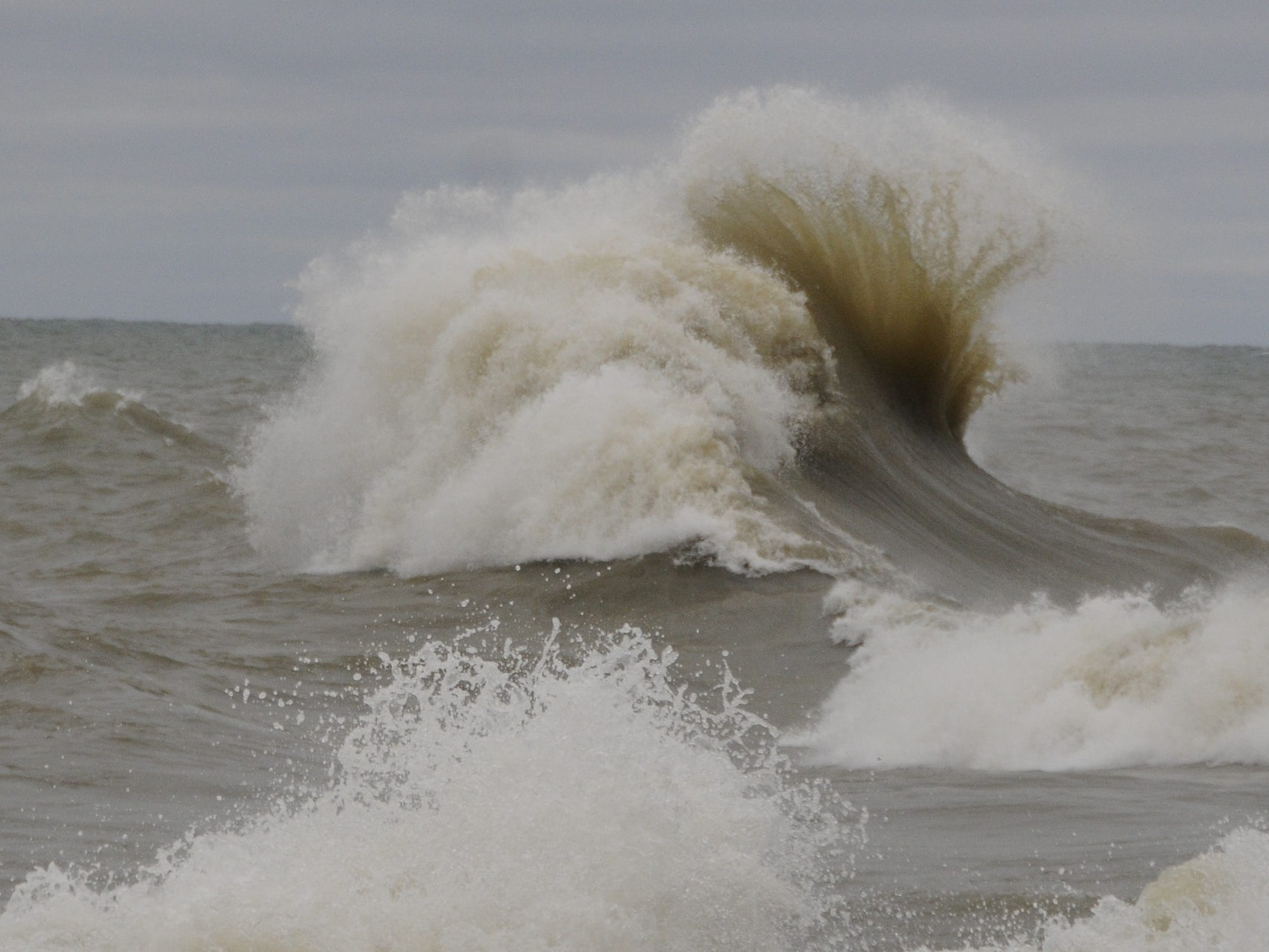 Two waves smash into each other in Lake Huron near Port Sanilac on New Year's Day 2019.