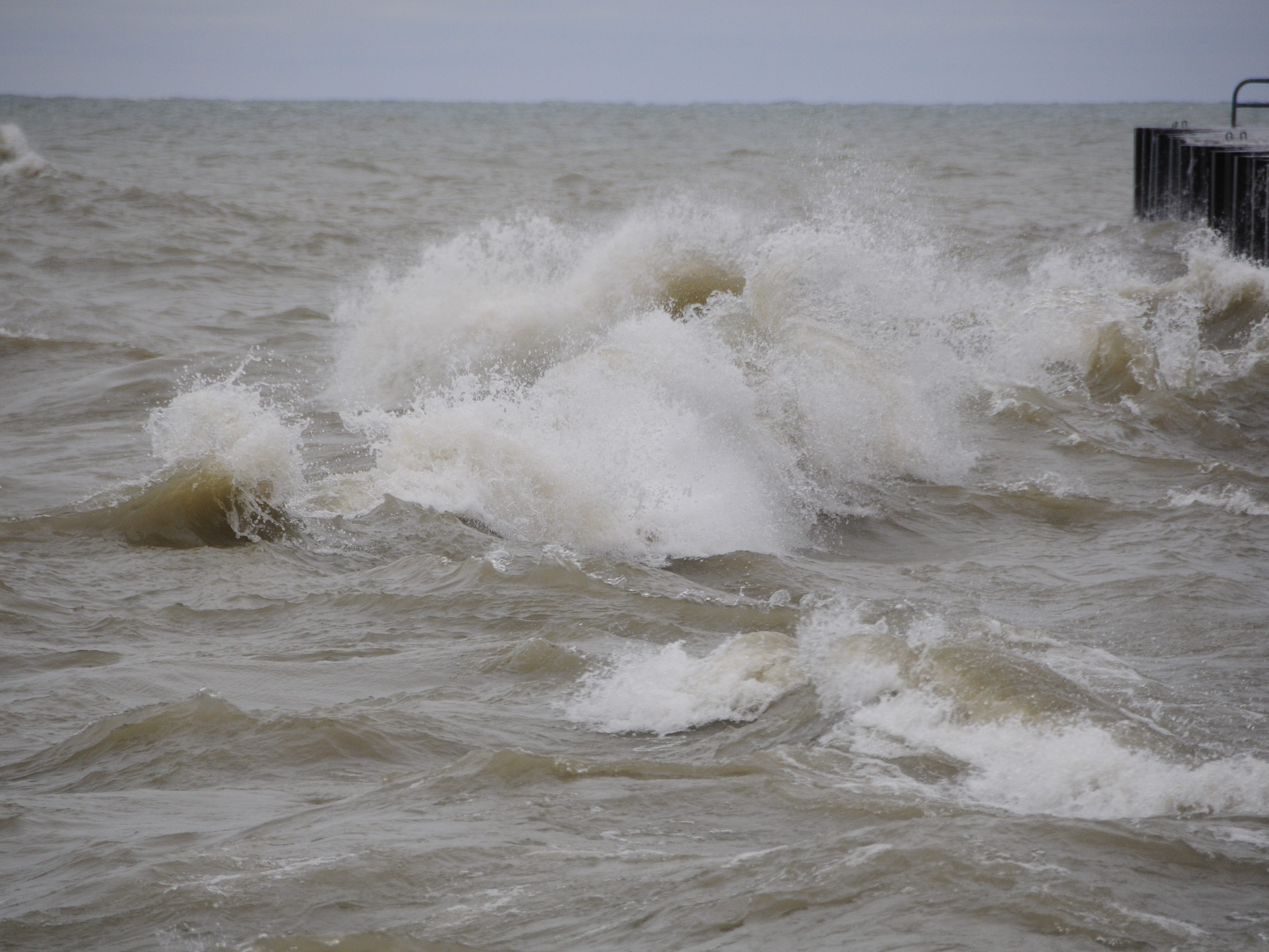 Waves boil ashore in Port Sanilac on New Year's Day 2019.