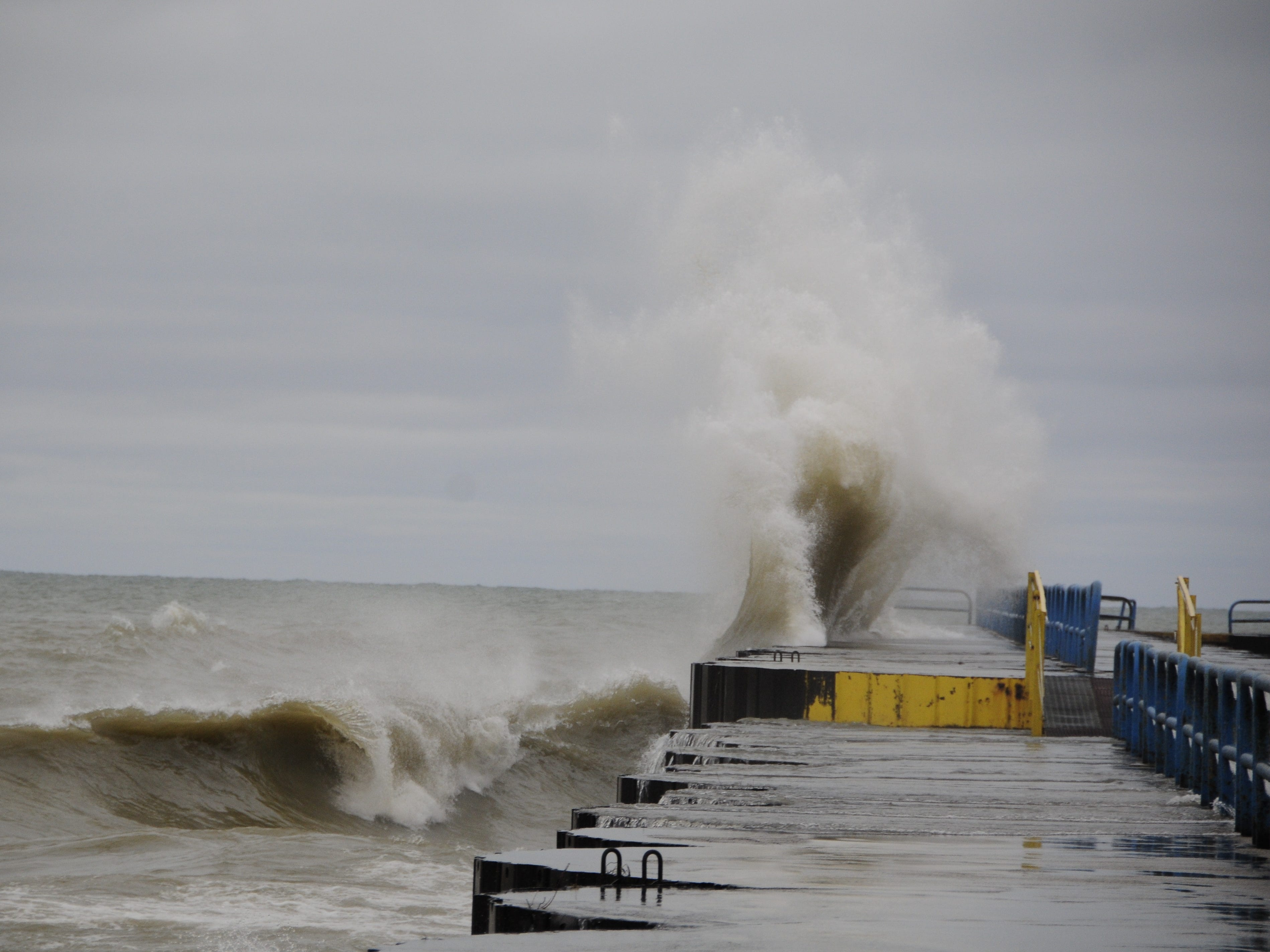 A big wave slams into the north breakwall in Port Sanilac on New Year's Day 2019.
