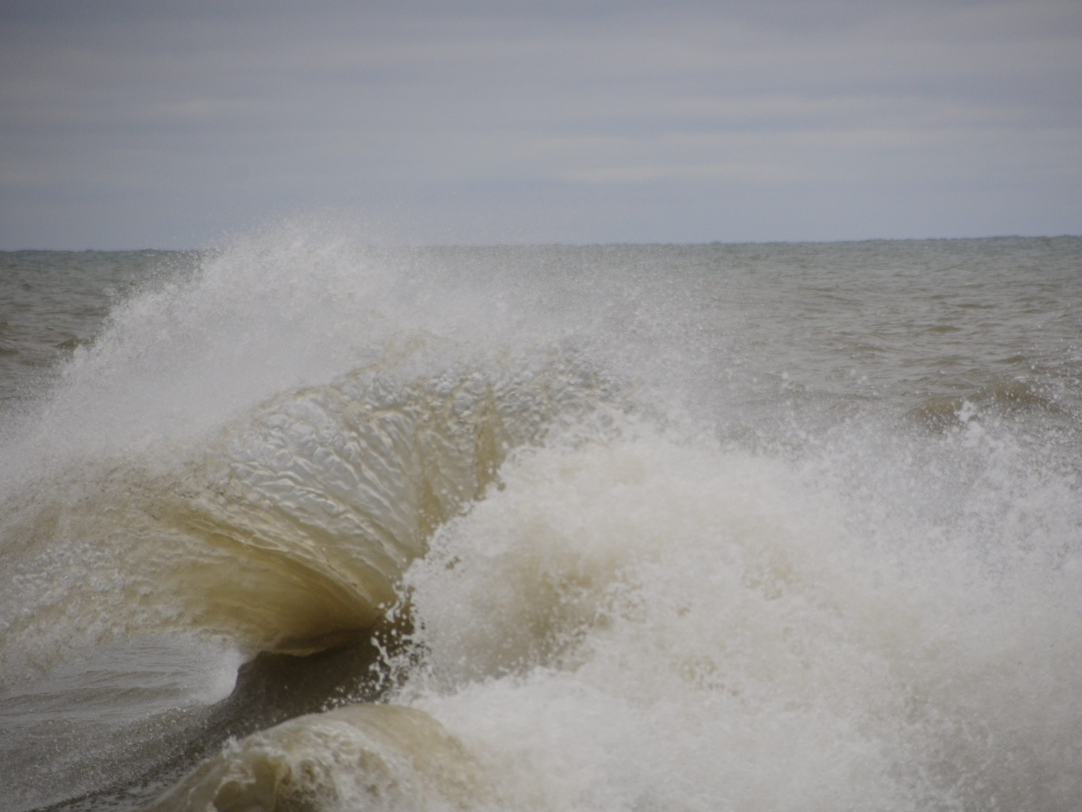 Waves leap into the air in Port Sanilac on New Year's Day 2019.