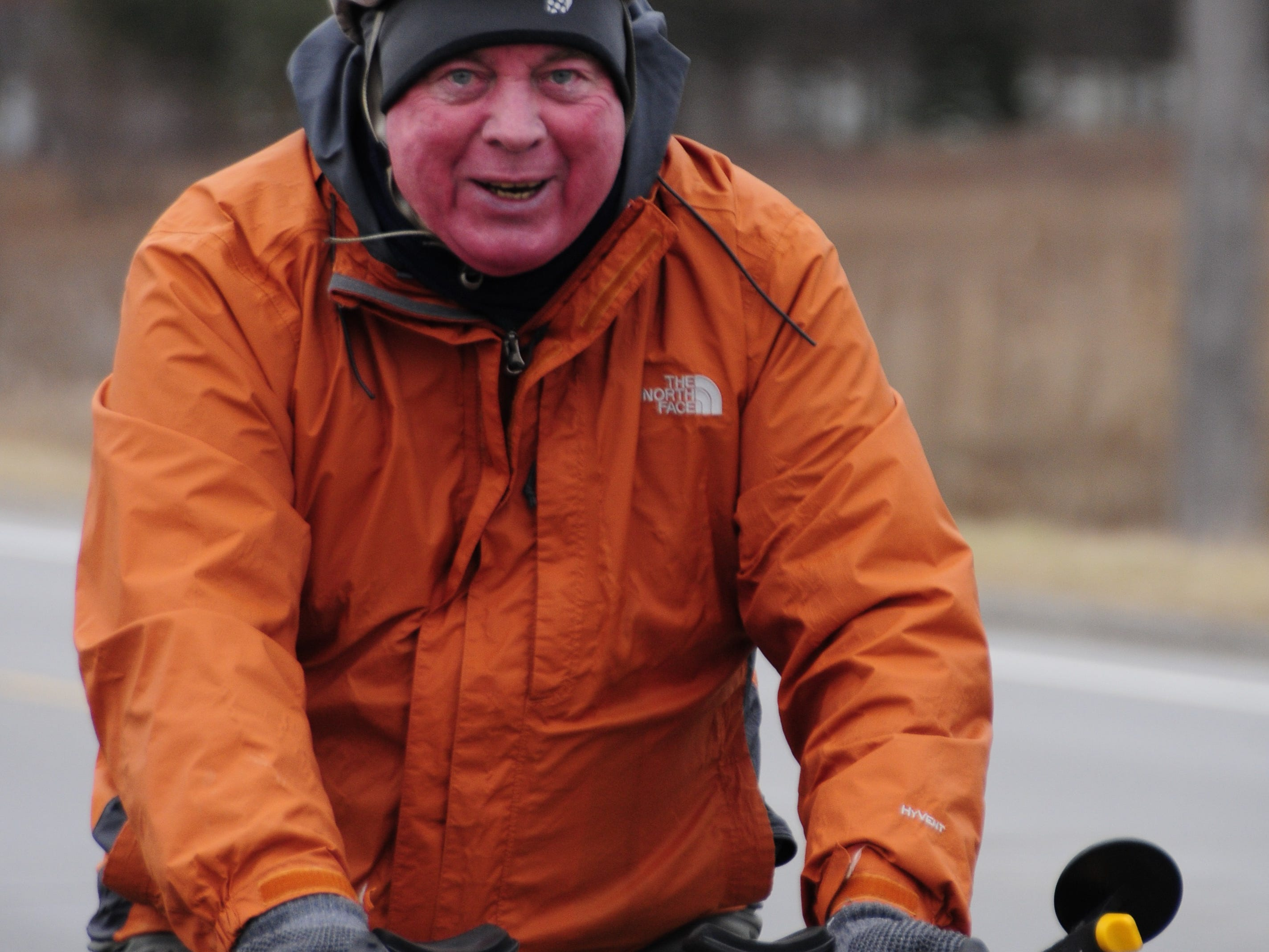 Mike Ziegler climbs a long hill at the start of the Lexington to Croswell New Year's Bike Ride.