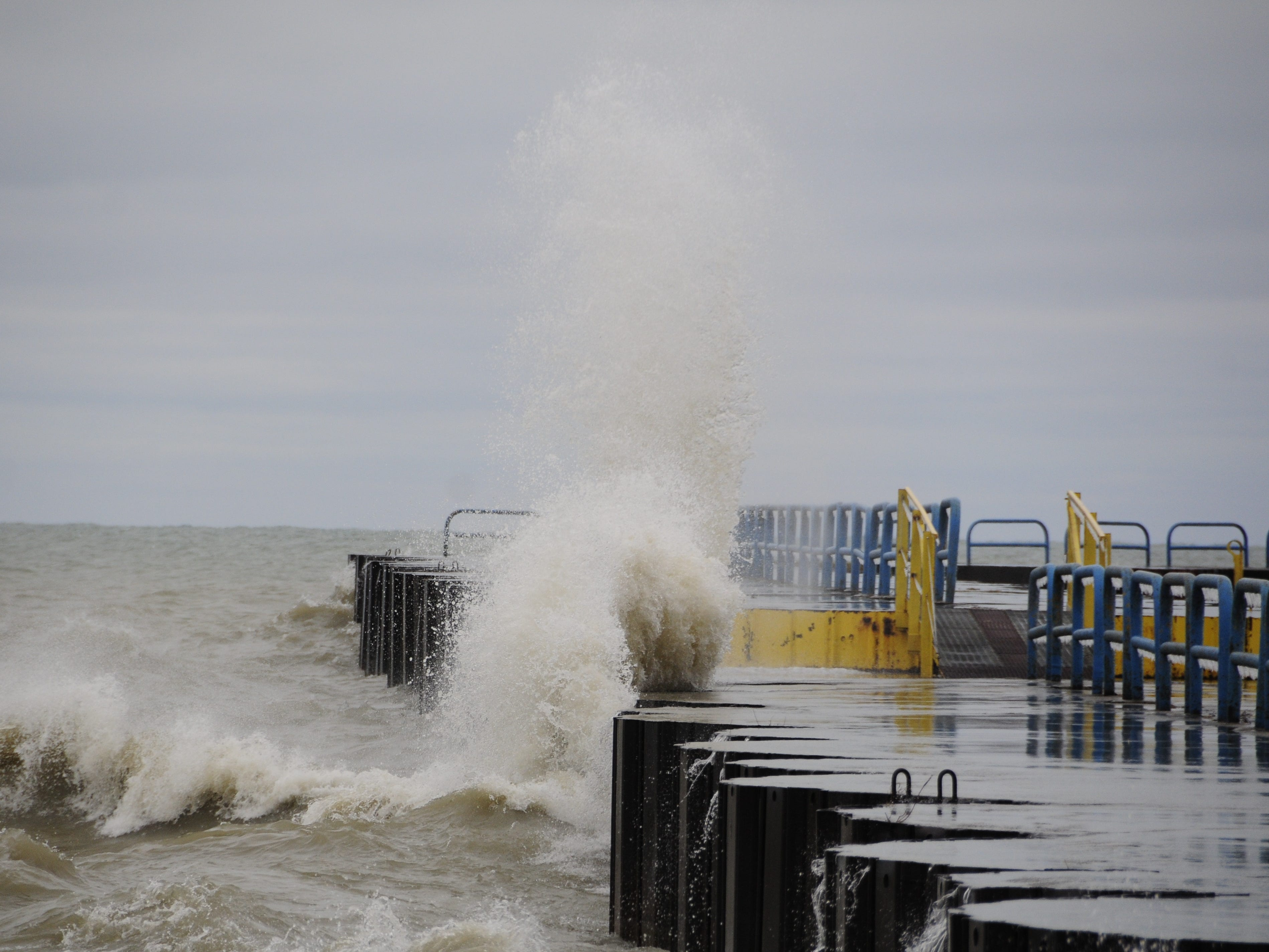A wave smacks into the north breakwall in Port Sanilac on New Year's Day 2019.