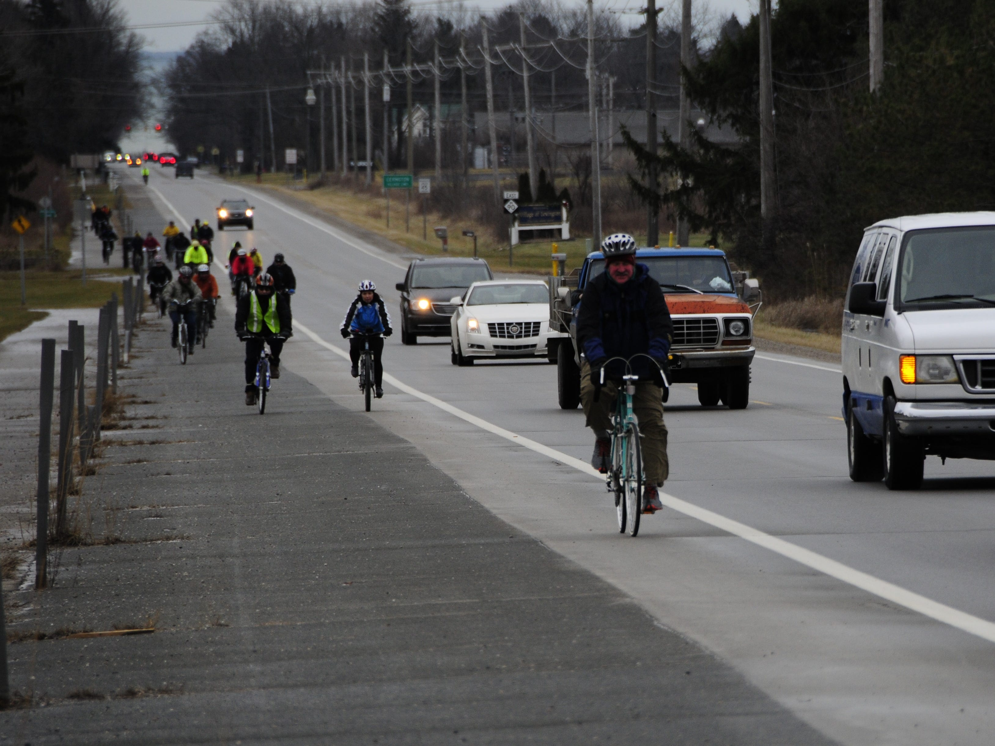 Cyclists climb a long hill west of Lexington during the Lexington to Croswell New Year's Bike Ride.