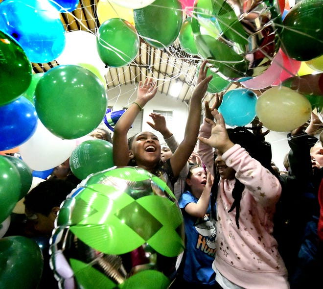China Bowman, 8, of York City, center, and other children are cascaded in balloon during the Children's New Year's Eve Countdown at Voni Grimes Gym Monday, Dec. 31, 2018. The event included family-friendly entertainment culminating with the balloon drop at 8 p.m. Bill Kalina photo