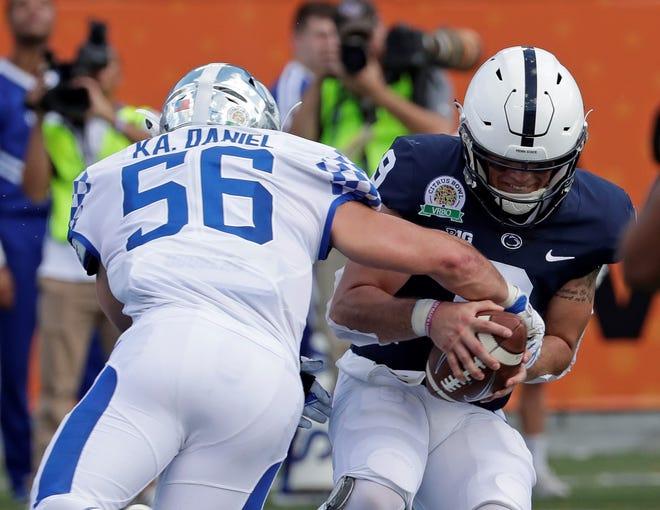 Kentucky linebacker Kash Daniel (56) sacks Penn State quarterback Trace McSorley during the first half of the Citrus Bowl NCAA college football game, Tuesday, Jan. 1, 2019, in Orlando, Fla. (AP Photo/John Raoux)
