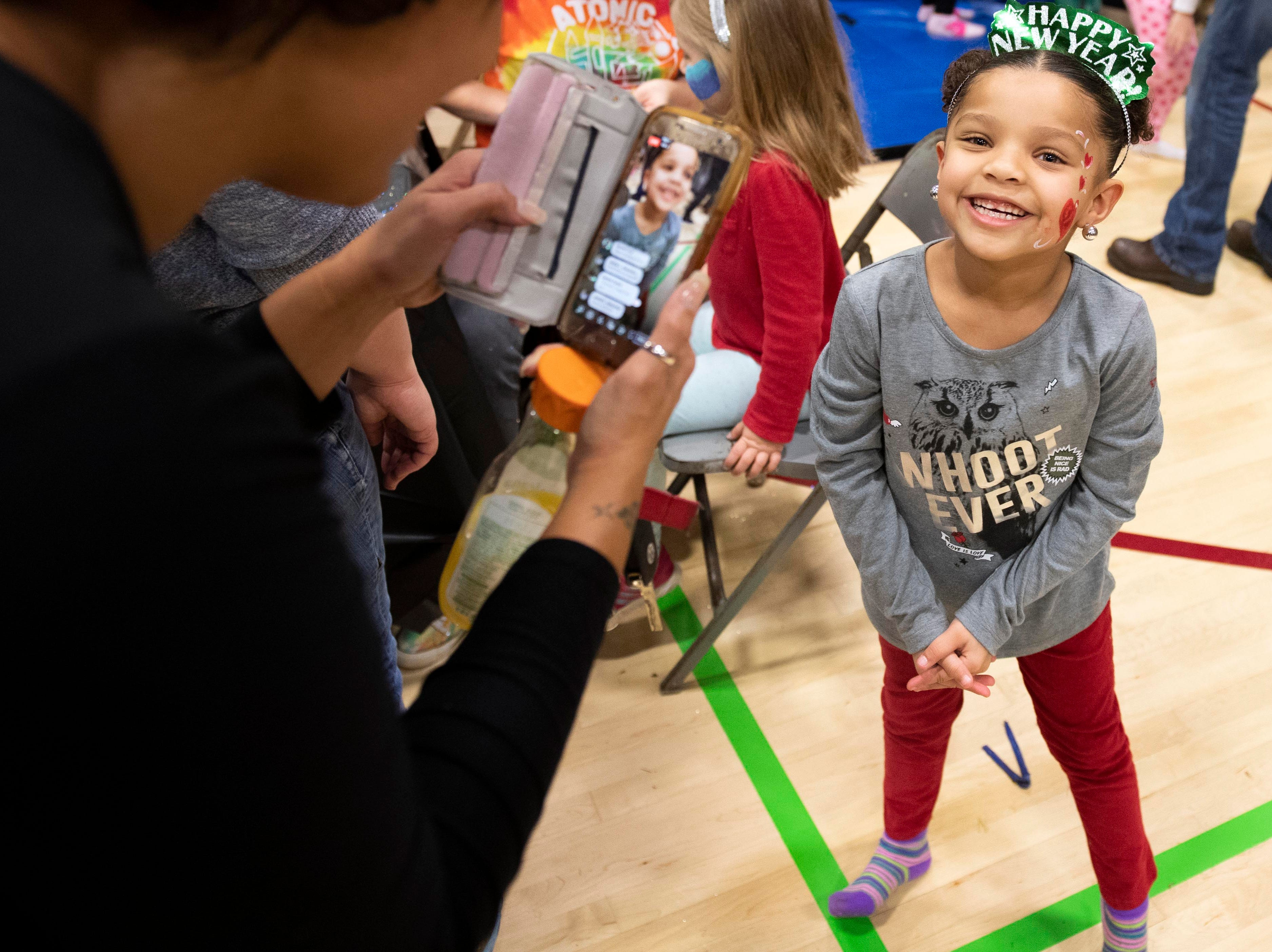 Lola Rae Gomez, 5, laughs while her mom does a Facebook Live during the Children's Countdown to 2019 event at Voni Grimes Gym, Monday, Dec. 31, 2018. Hundreds of kids rang in 2019 with a balloon drop at 8 p.m.