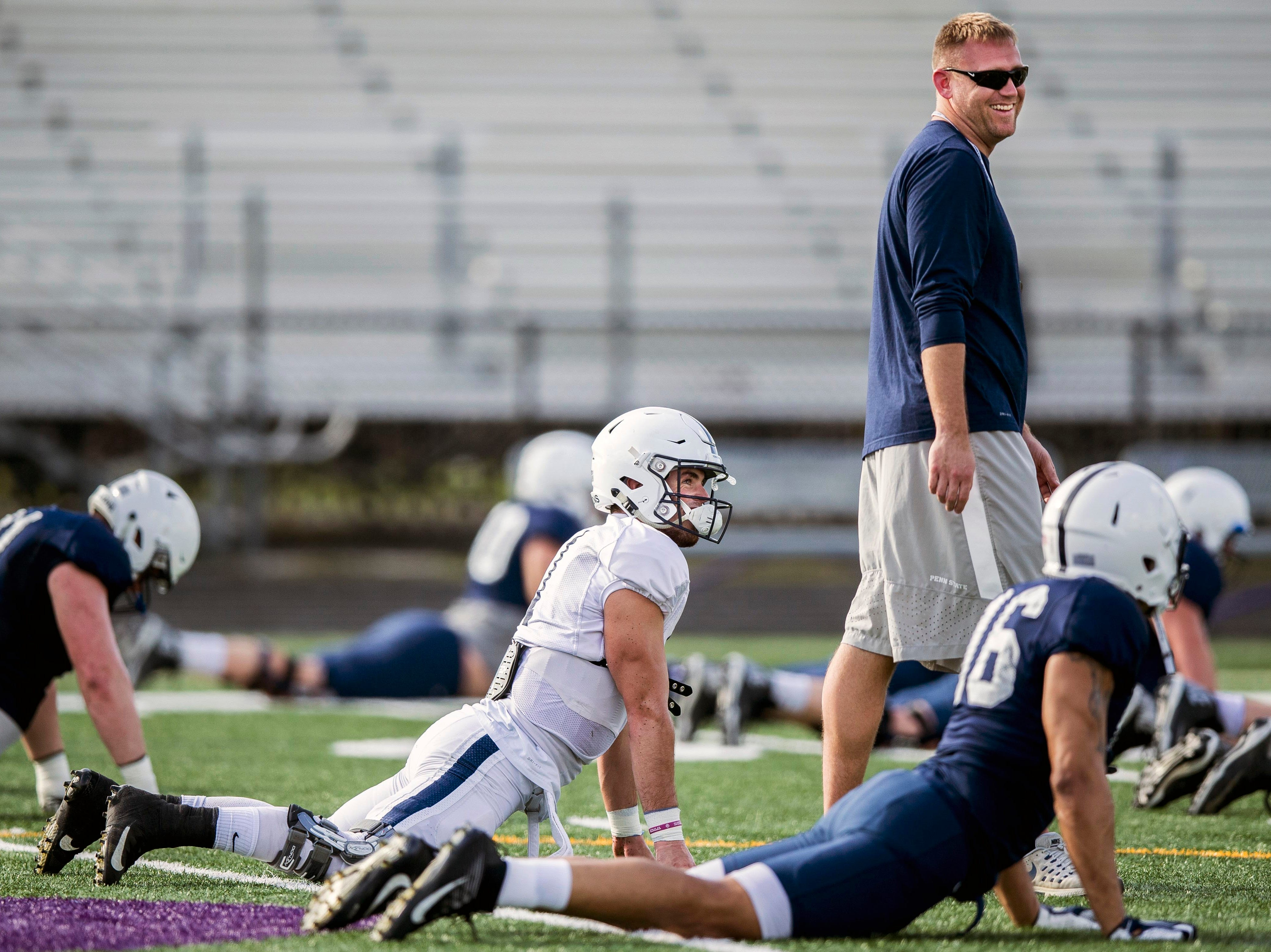 Penn State offensive coordinator Ricky Rahne jokes with quarterback Trace McSorley during practice for the Citrus Bowl, Sunday, Dec. 30, 2018 in Orlando, Fla. Penn State plays Kentucky in the Citrus Bowl on Tuesday, Jan. 1, 2019. (Joe Hermitt/The Patriot-News via AP)