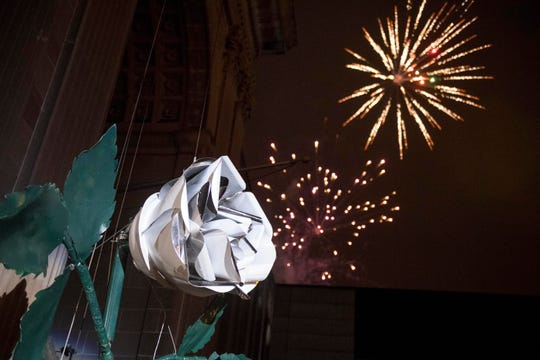 Fireworks blast into the sky following the white rose drop at midnight in Continental Square downtown, Tuesday, Jan. 1, 2019. Hundreds gathered to watch the white rose drop, dance and ring in the new year.