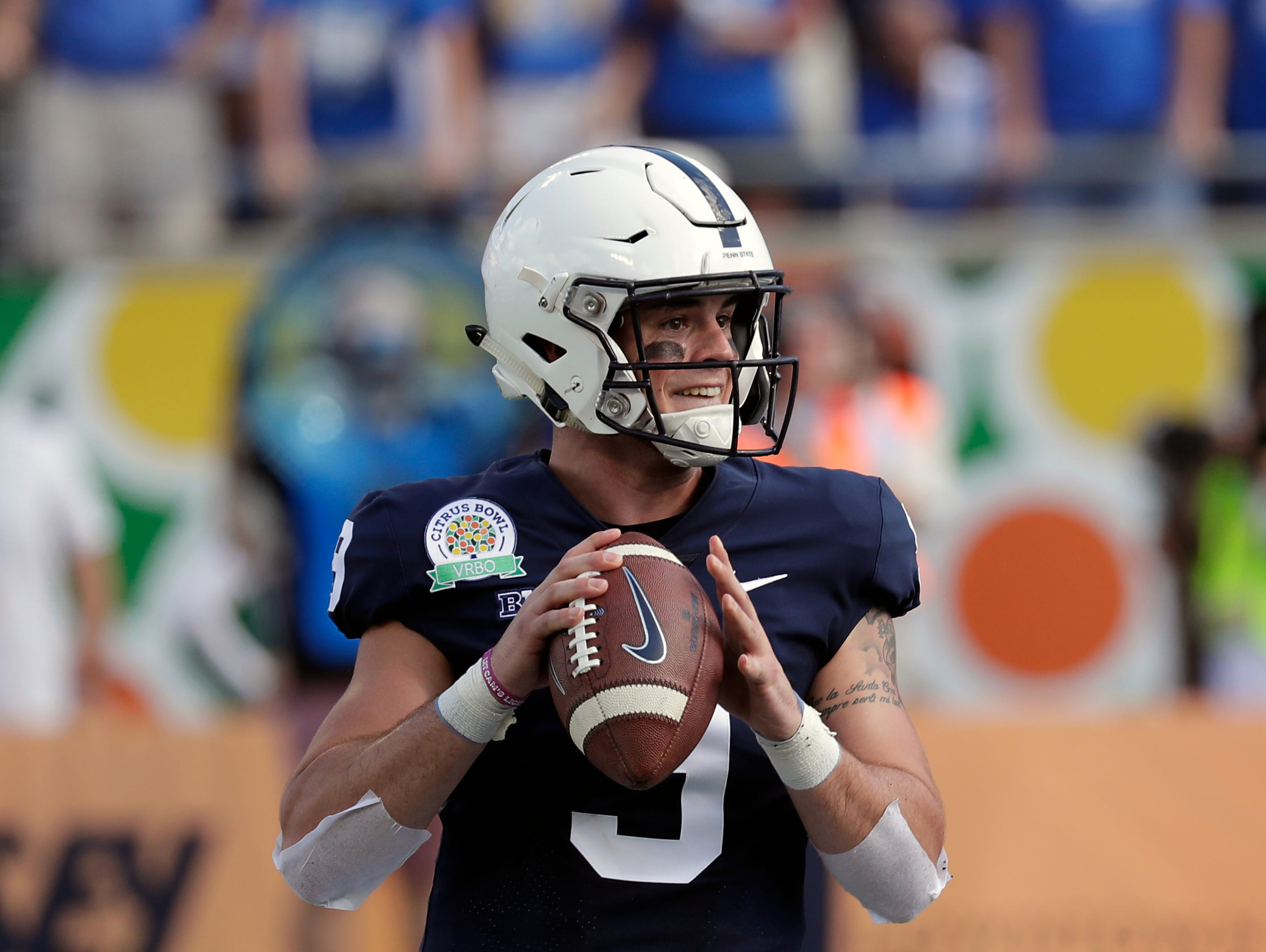Penn State quarterback Trace McSorley looks for a receiver against Kentucky during the first half of the Citrus Bowl NCAA college football game, Tuesday, Jan. 1, 2019, in Orlando, Fla. (AP Photo/John Raoux)