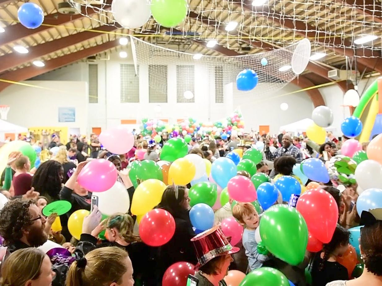 Hundreds of balloons drop as the clock strikes 8 p.m. during the Children's Countdown to 2019 event at Voni Grimes Gym, helping kids ring in the New Year.