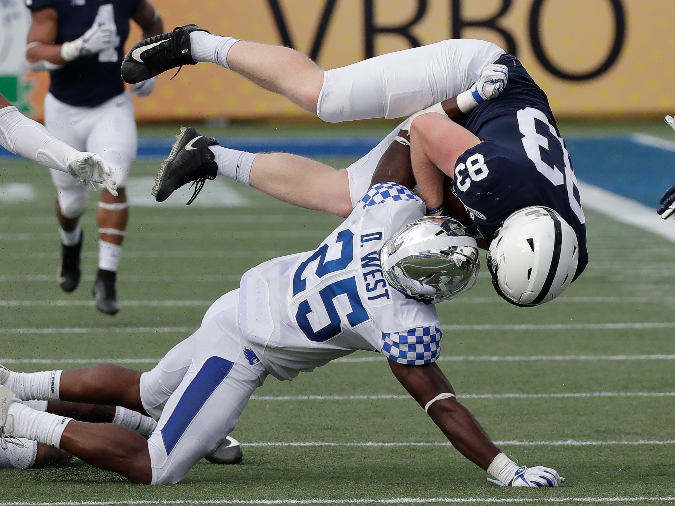 Penn State tight end Nick Bowers (83) is stopped after a reception by Kentucky safety Darius West (25) during the second half of the Citrus Bowl NCAA college football game, Tuesday, Jan. 1, 2019, in Orlando, Fla. (AP Photo/John Raoux)