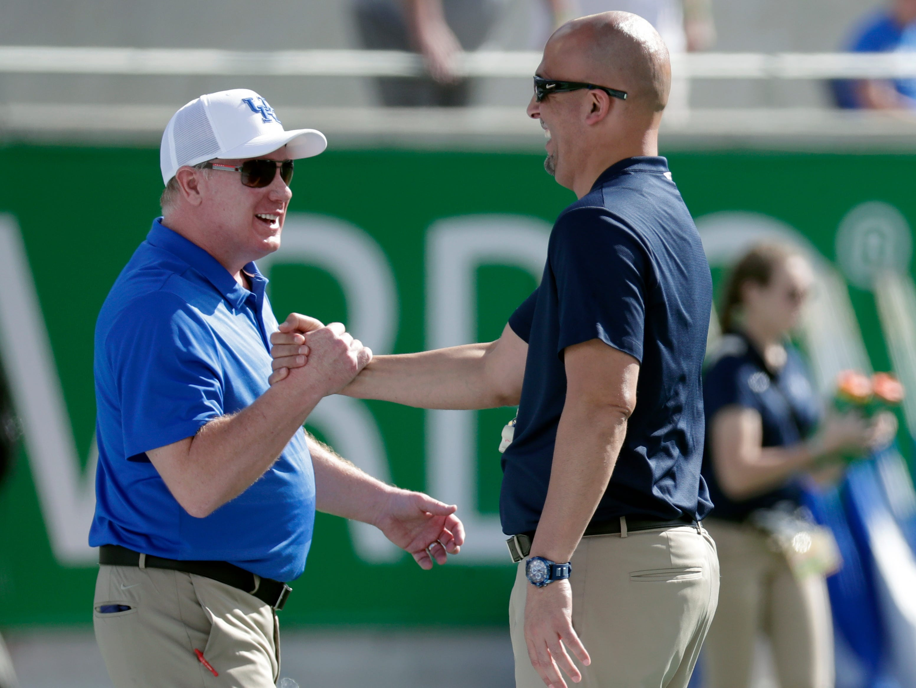 Kentucky head coach Mark Stoops, left, greets Penn State head coach James Franklin at midfield before during the start of the Citrus Bowl NCAA college football game, Tuesday, Jan. 1, 2019, in Orlando, Fla. (AP Photo/John Raoux)