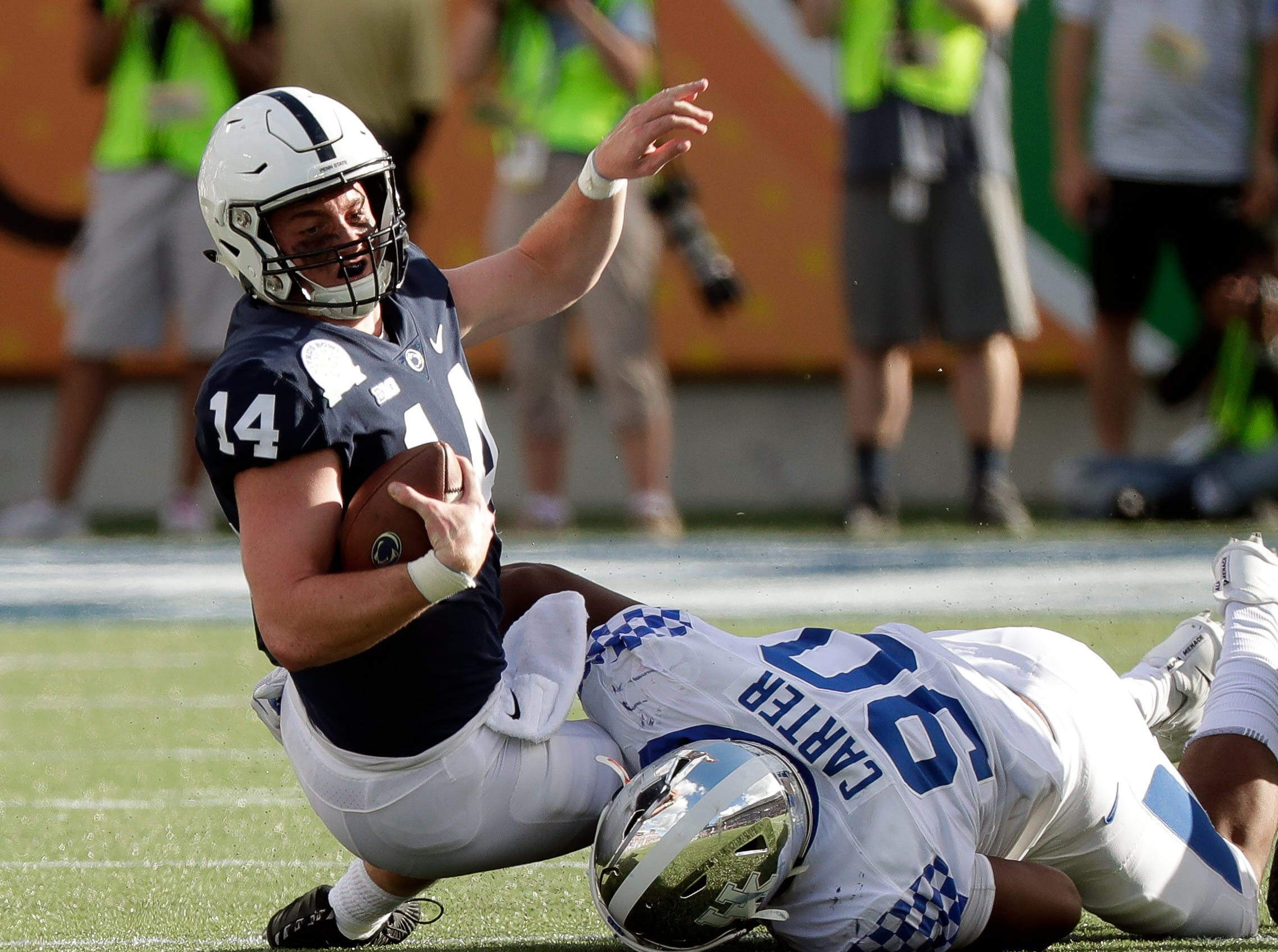 Kentucky defensive end T.J. Carter (90) sacks Penn State quarterback Sean Clifford (14) during the second half of the Citrus Bowl NCAA college football game, Tuesday, Jan. 1, 2019, in Orlando, Fla. (AP Photo/John Raoux)
