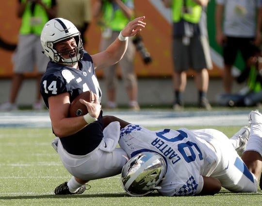 Kentucky defensive end T.J. Carter (90) sacks Penn State quarterback Sean Clifford (14) during the second half of the Citrus Bowl NCAA college football game, Tuesday, Jan. 1, 2019, in Orlando, Fla. (AP Photo/John Raoux)