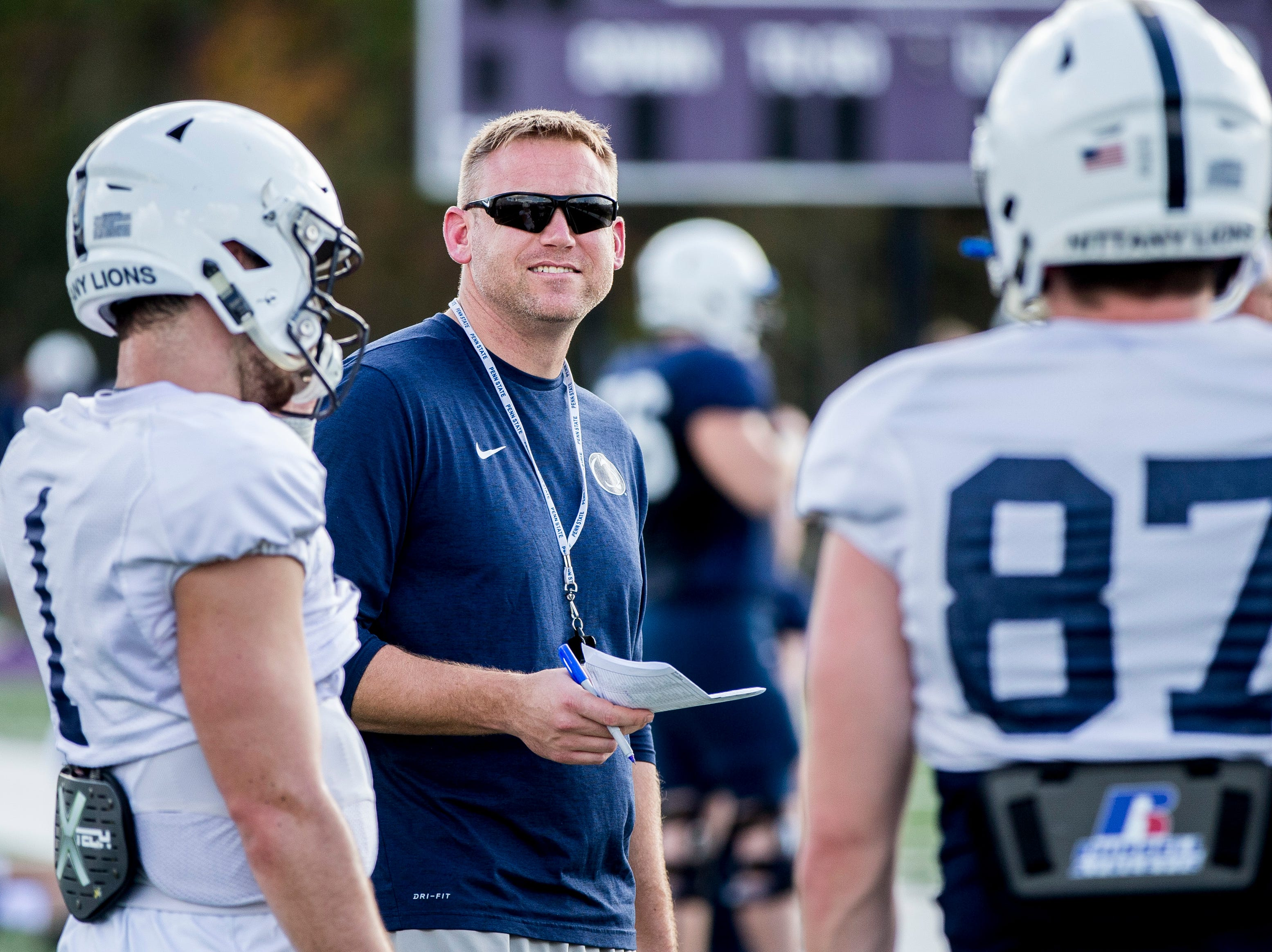 Penn State offensive coordinator Ricky Rahne talks with quarterback Trace McSorley during practice for the Citrus Bowl, Sunday, Dec. 30, 2018 in Orlando, Fla. Penn State plays Kentucky in the Citrus Bowl on Tuesday, Jan. 1, 2019. (Joe Hermitt/The Patriot-News via AP)