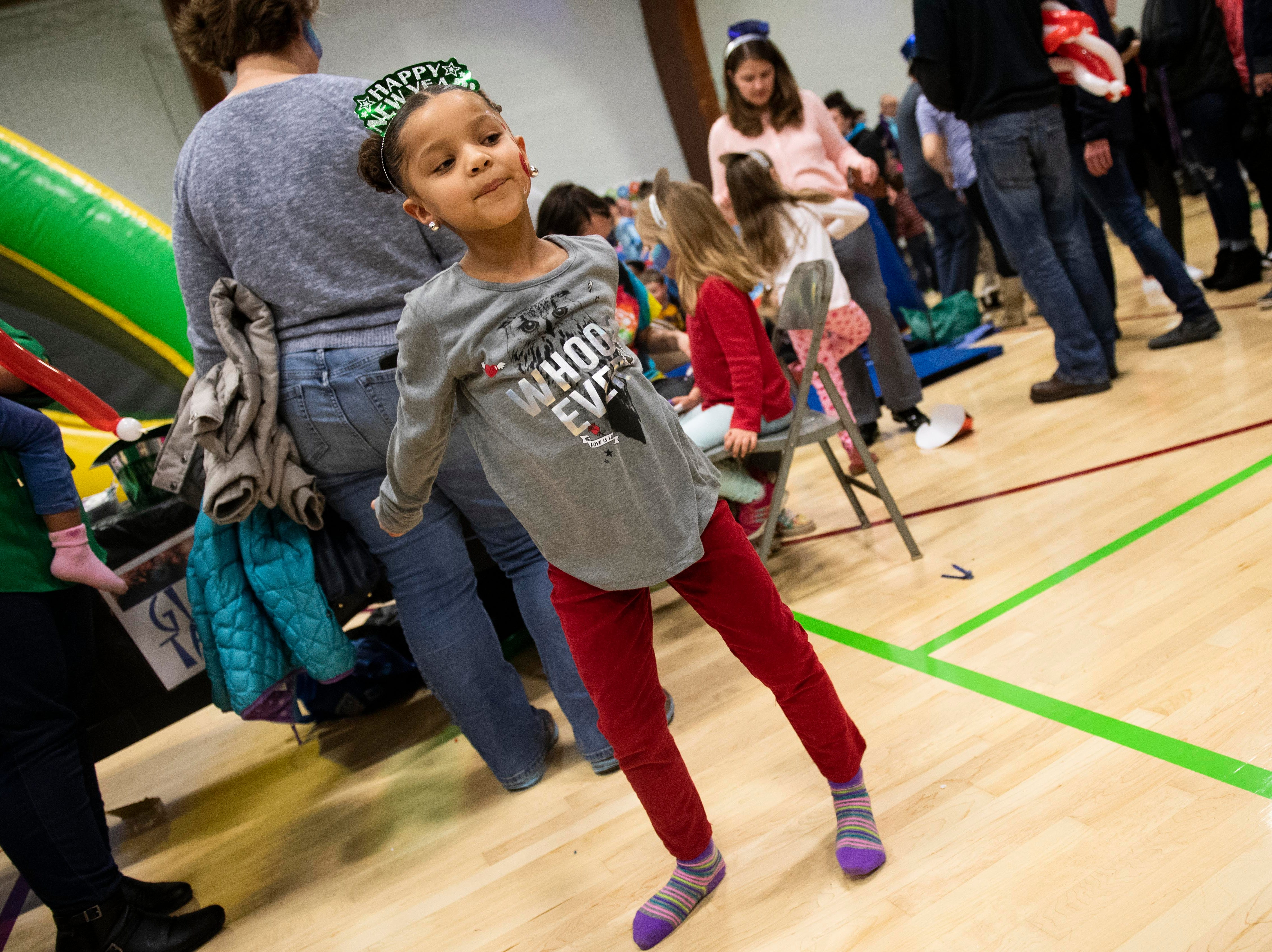 Lola Rae Gomez, 5, dances during the Children's Countdown to 2019 event at Voni Grimes Gym, Monday, Dec. 31, 2018. Hundreds of kids rang in 2019 with a balloon drop at 8 p.m.