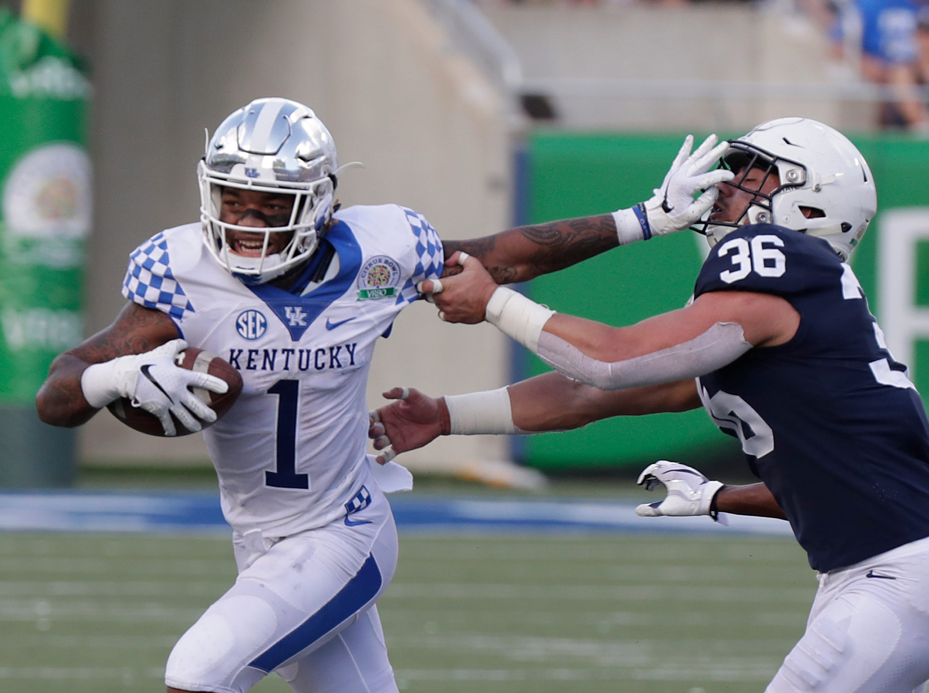 Kentucky wide receiver Lynn Bowden Jr. (1) tries to get past Penn State linebacker Jan Johnson (36) during the second half of the Citrus Bowl NCAA college football game, Tuesday, Jan. 1, 2019, in Orlando, Fla. (AP Photo/John Raoux)