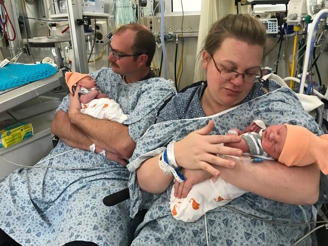 Craig and Jennifer Robbins, of Redding, hold their newborn twins Ammon, left, and Leland Tuesday, January 1, 2019 at Mercy Medical Center in Redding. The twins were the city's first births of 2019.