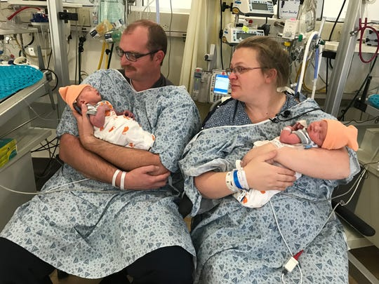 Craig and Jennifer Robbins, of Redding, hold newborn twins Ammon, left, and Leland Tuesday, January 1, 2019 at Mercy Medical Center in Redding. The boys were the city's first babies born in 2019.