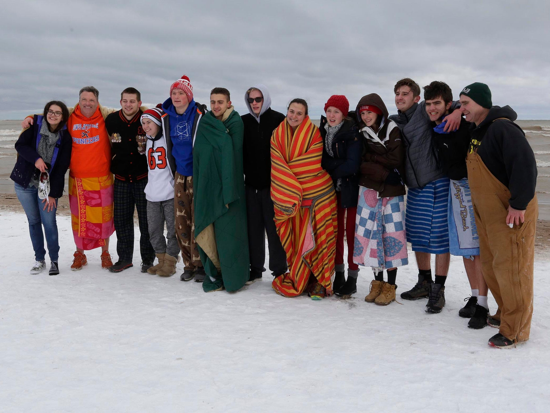 AFS students from Plymouth High School pose after participating in the annual Polar Bear Plunge, Tuesday, January 1, 2019, at Deland Park in Sheboygan, Wis. According to AFS advisor Ann Weeden, students from many countries including Denmark, Norway, Macedonia, Spain, Italy, Jordan and Japan participated in the dip.