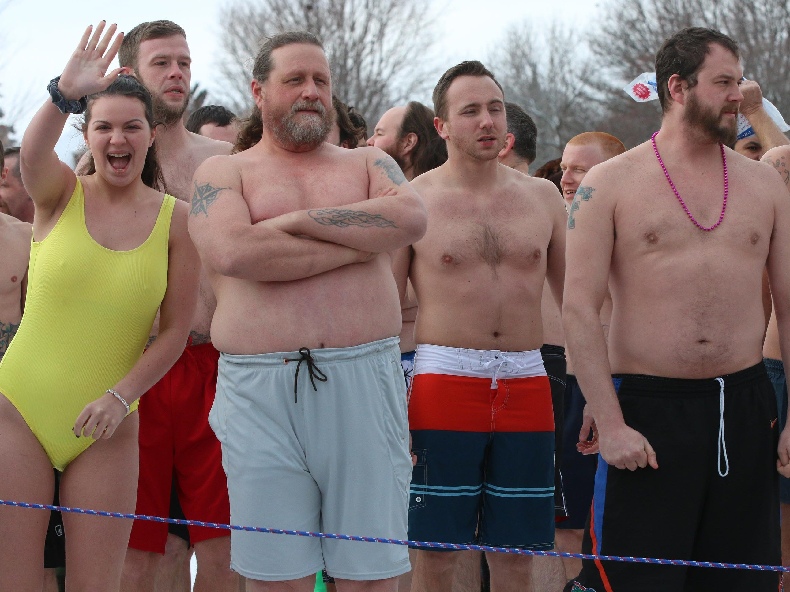 Polar Bears await the count down for their annual plunge into Lake Michigan, Tuesday, January 1, 2019, at Deland Park in Sheboygan, Wis.