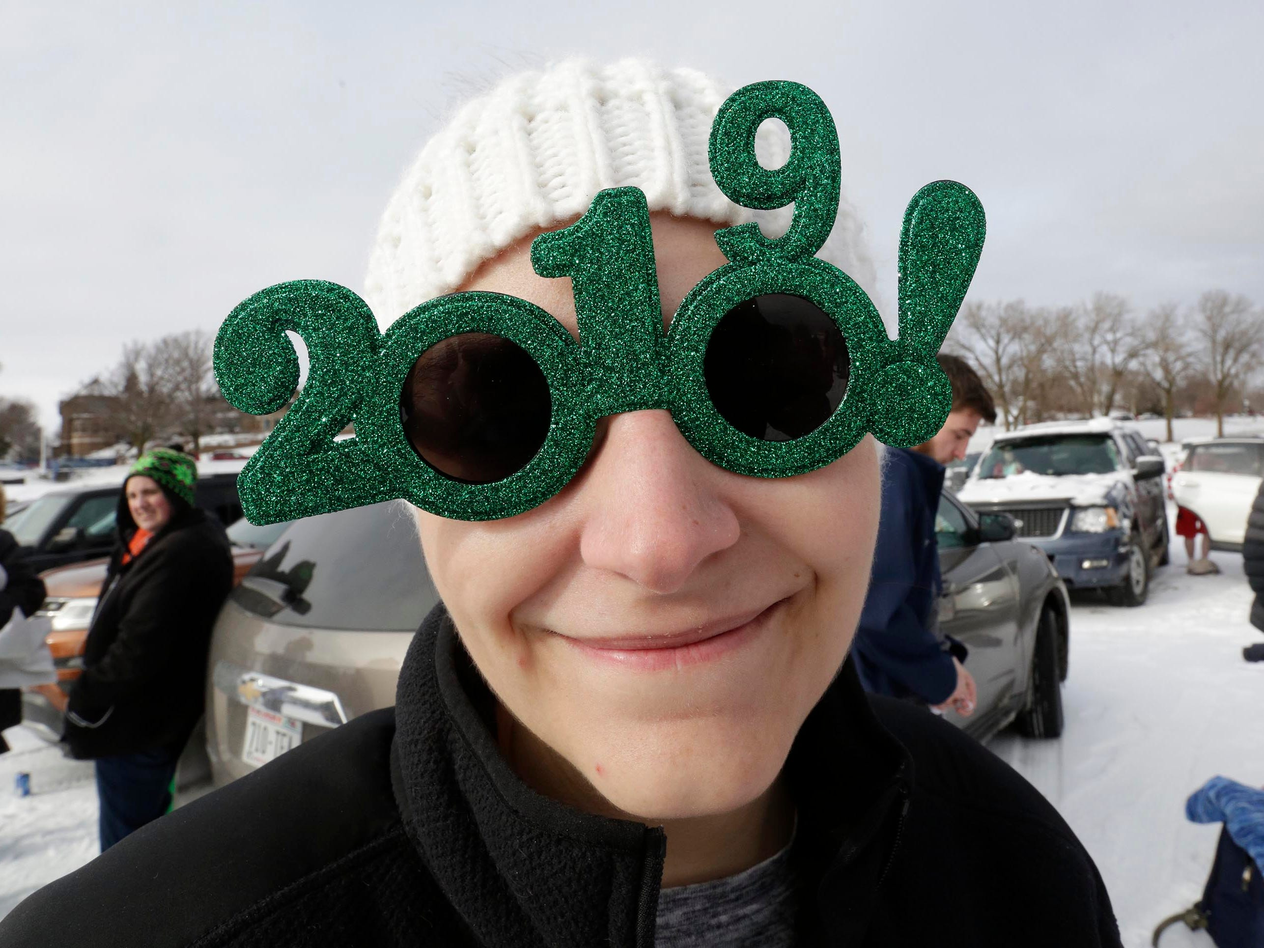Andrea Barrera of Sheboygan, sports a pair of 2019 party sunglasses at the Polar Bear Plunge, Tuesday, January 1, 2019, at Deland Park in Sheboygan, Wis.