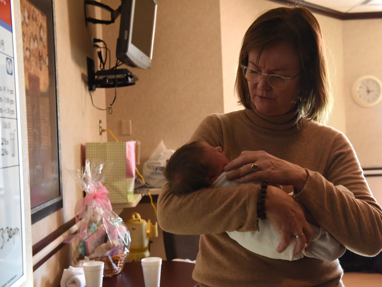 Bobbie Bohlen holds her new granddaughter Lauren Louise Bohlen, Tuesday, Jan. 1, 2019 at Sanford Health in Sioux Falls, S.D. Lauren was the first baby born at Sanford in 2019.