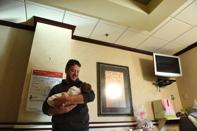 Chris Bohlen holds his new daughter Lauren Louise Bohlen, Tuesday, Jan. 1, 2019 at Sanford Health in Sioux Falls, S.D. Lauren was the first baby born at Sanford in 2019.