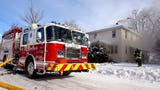 St. Cloud firefighters extinguish a fire that started in a basement laundry room Tuesday, Jan. 1, at 206-19 1/2 Ave. N.