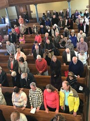 People of various faiths met Tuesday at the St. George Tabernacle to ring in the new year with the annual 'Prayer Over the City.'