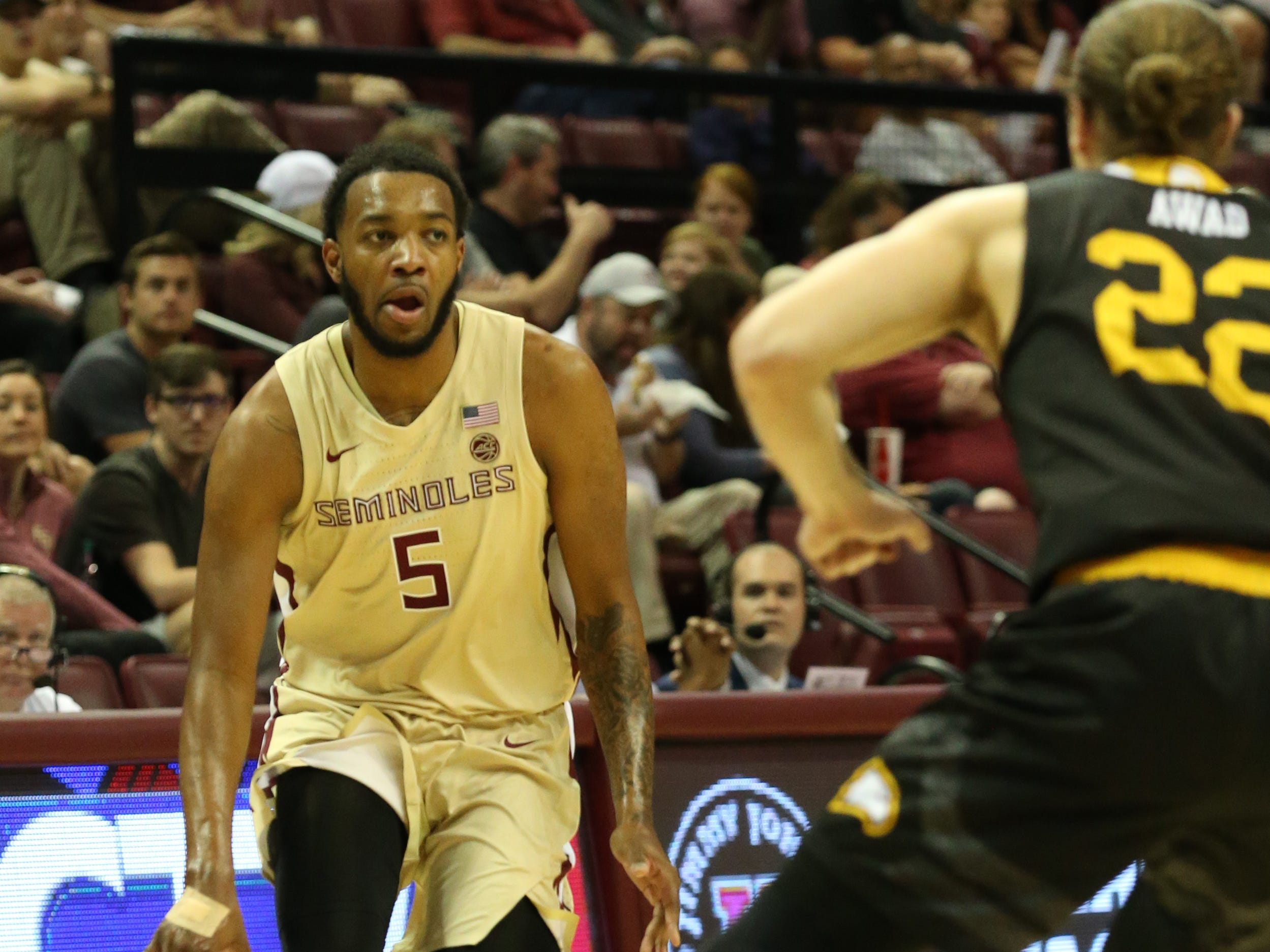Florida State Seminoles guard PJ Savoy (5) drives the ball down the court as the Florida State Seminoles host the Winthrop Eagles for men's basketball at the Tucker Civic Center, Tuesday, Jan. 1, 2019.