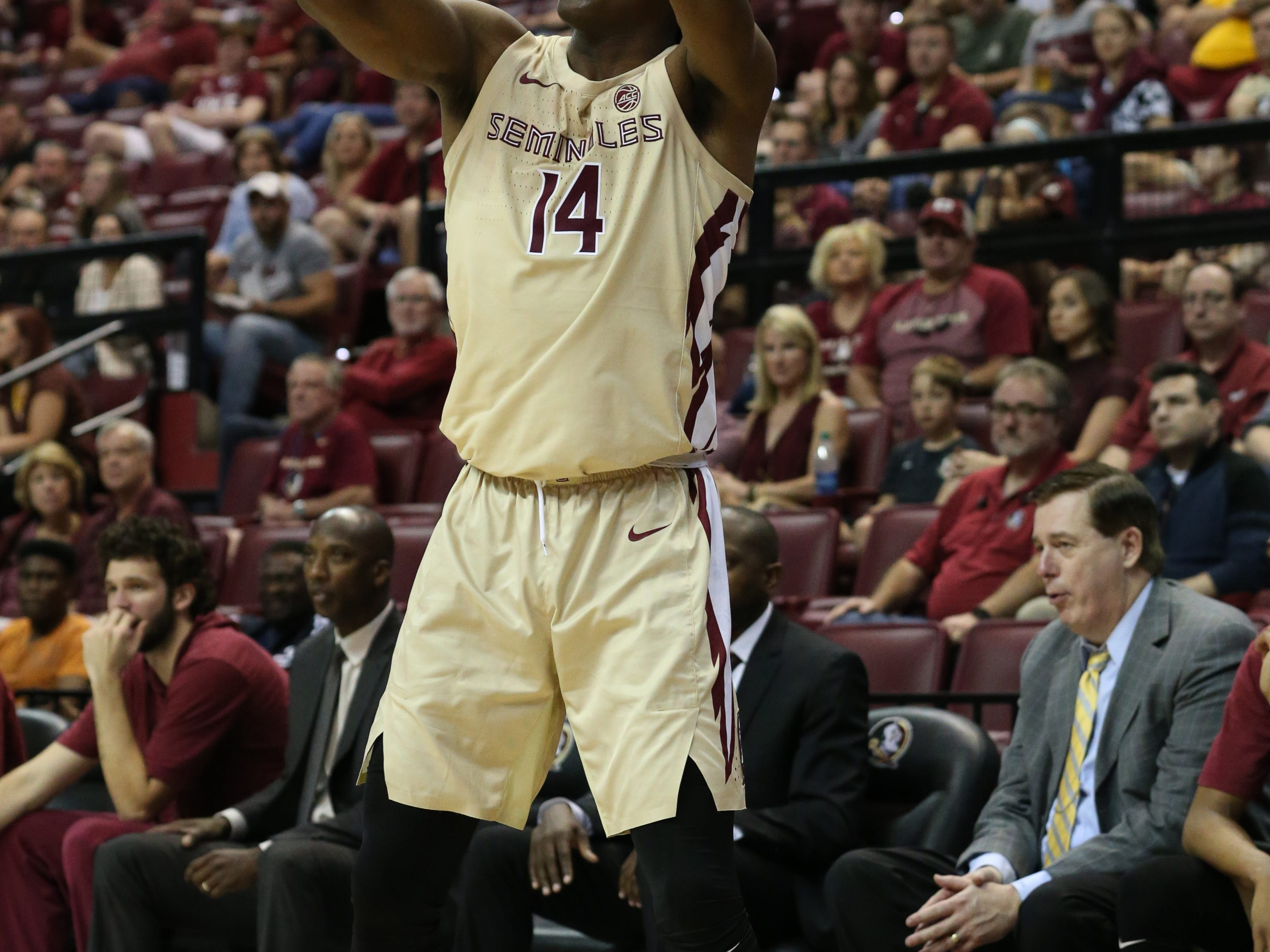 Florida State Seminoles guard Terance Mann (14) shoots for three as the Florida State Seminoles host the Winthrop Eagles for men's basketball at the Tucker Civic Center, Tuesday, Jan. 1, 2019.