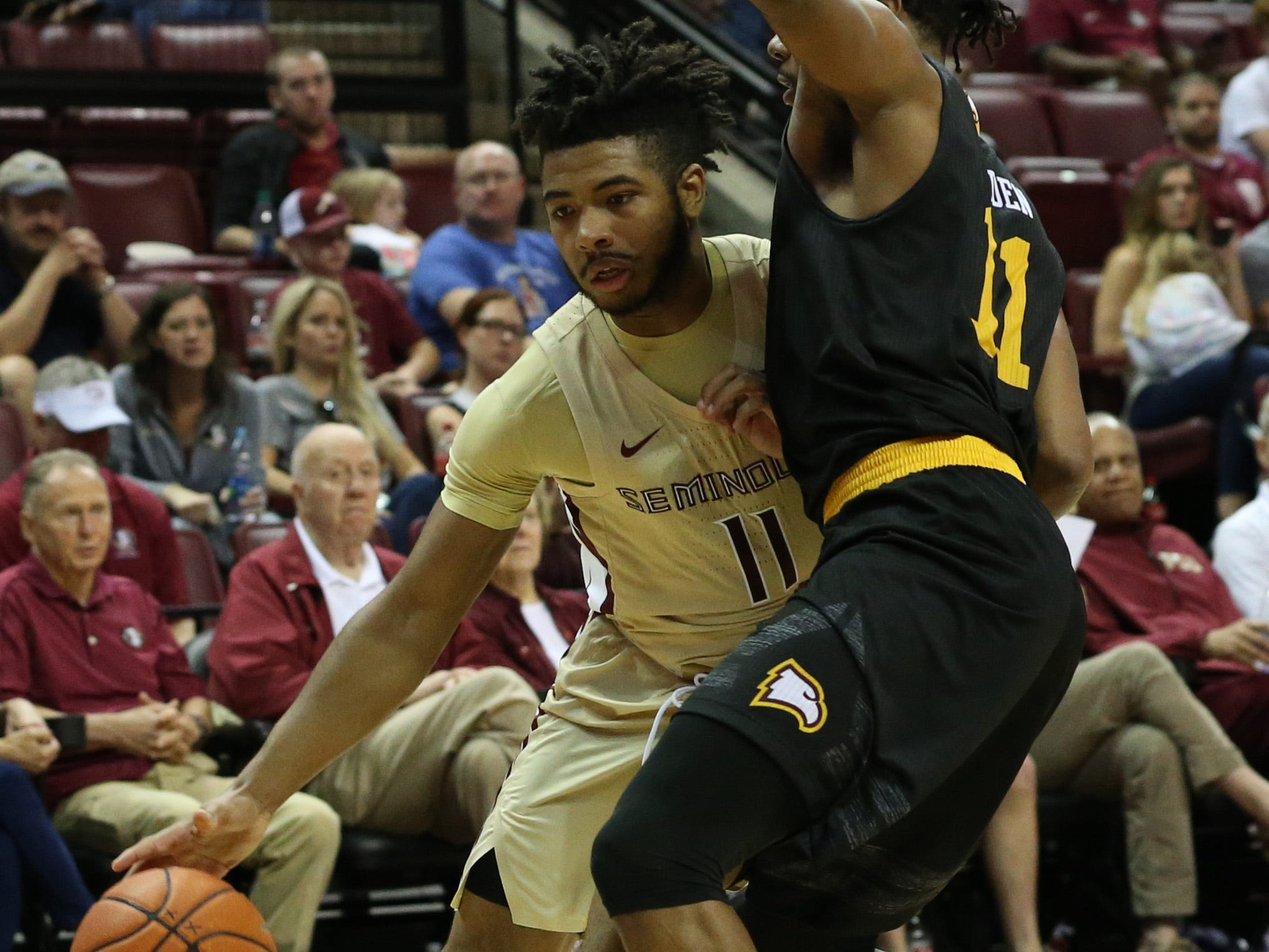 Florida State Seminoles guard David Nichols (11) drives the ball towards the hoop as the Florida State Seminoles host the Winthrop Eagles for men's basketball at the Tucker Civic Center, Tuesday, Jan. 1, 2019.