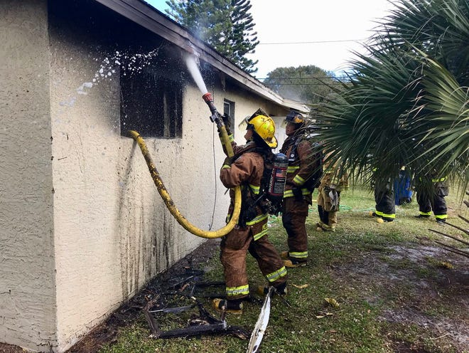 St. Lucie County Fire District crews put out a house fire in Fort Pierce on New Year's Day.