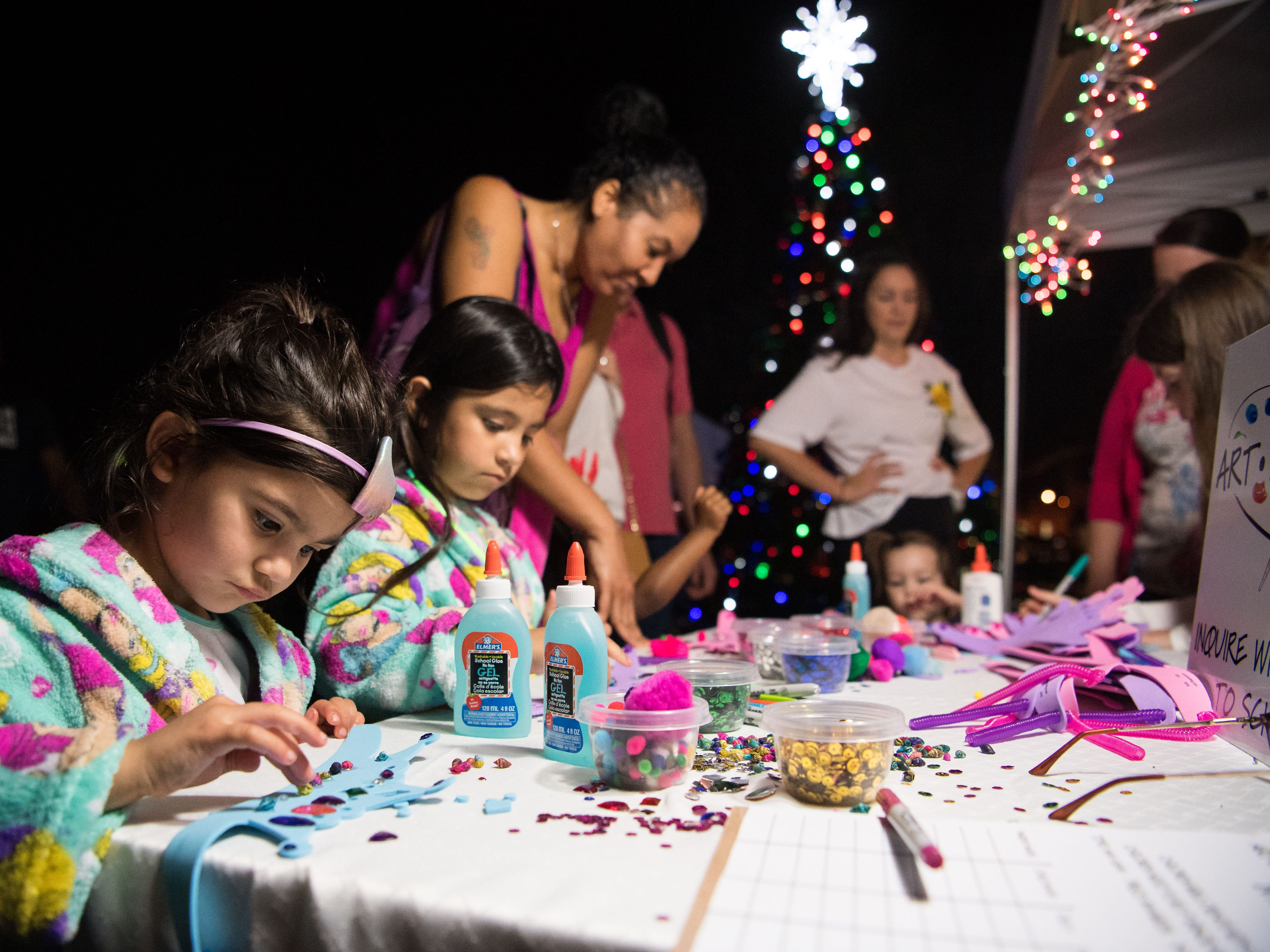 "Addalyne (left), 4,and her sister, Sophia, 6, no last name given, work on art projects at the Art Works table ahead of The Heritage Center's New Year's Eve ""Party of the Century — Diamonds Are Forever"" event Monday, Dec. 31, 2018, in downtown Vero Beach."