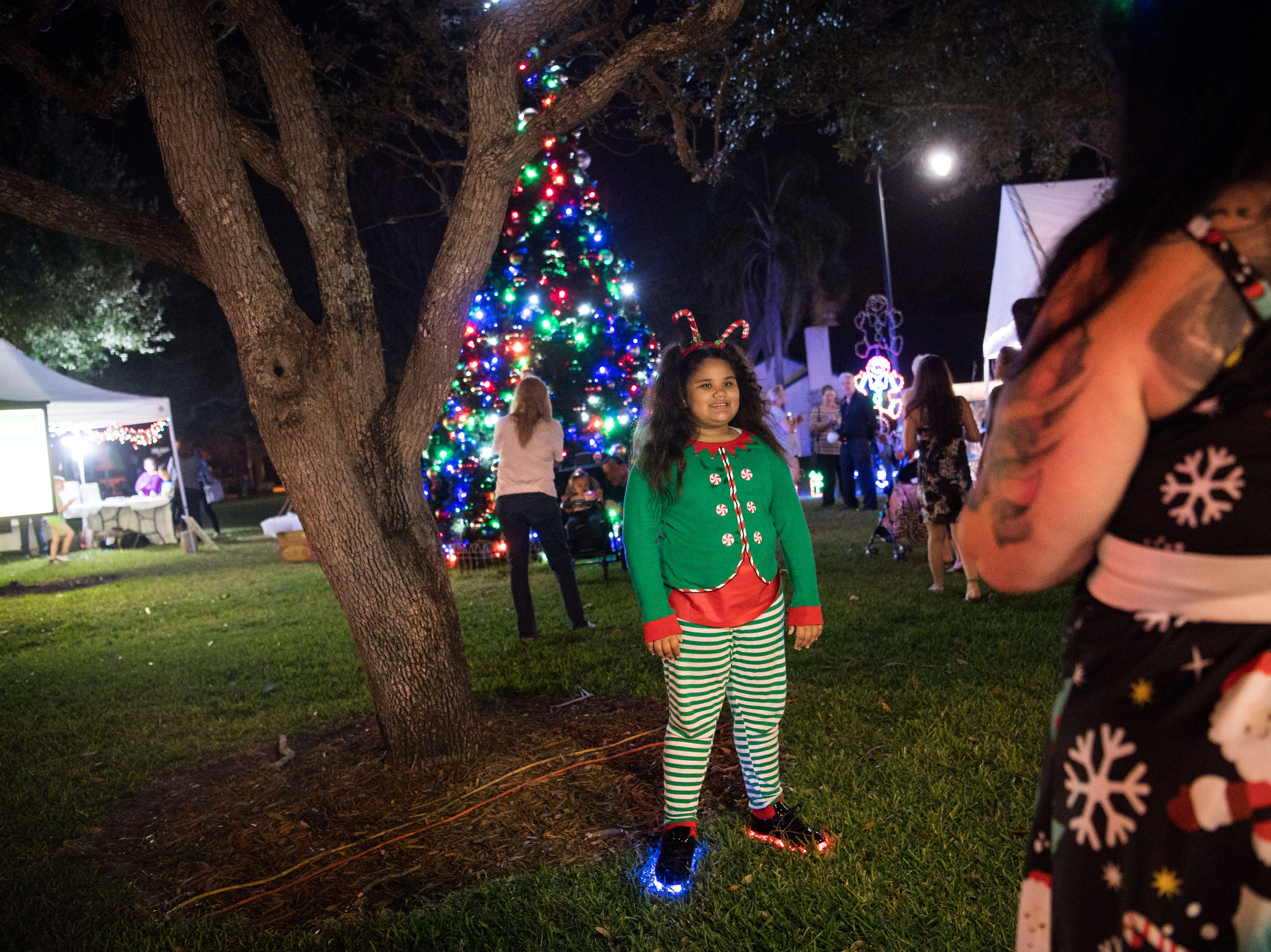 "People of all ages celebrate the new year and Vero Beach's centennial ahead of The Heritage Center's New Year's Eve ""Party of the Century — Diamonds Are Forever"" event Monday, Dec. 31, 2018, in downtown Vero Beach. The evening's festivities included a ball drop, light show, live entertainment, outdoor dance floor, fireworks, food and champagne."