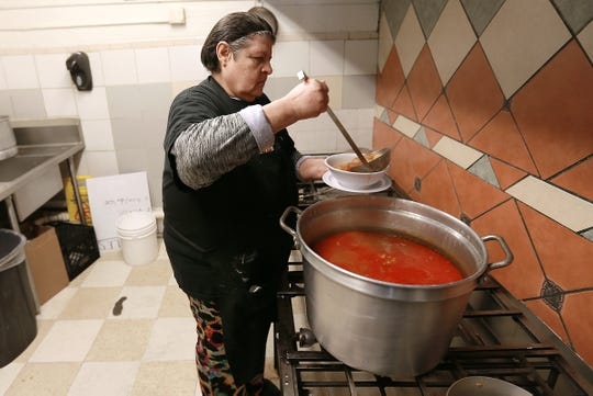 Maria Ramirez serves a bowl of menudo Tuesday morning at Jalisco Cafe, 1029 E. 7th Street in downtown El Paso. The self-proclaimed World Menudo Headquarters, the restaurant drew five winners of free menudo for a year, a new year's day tradition.