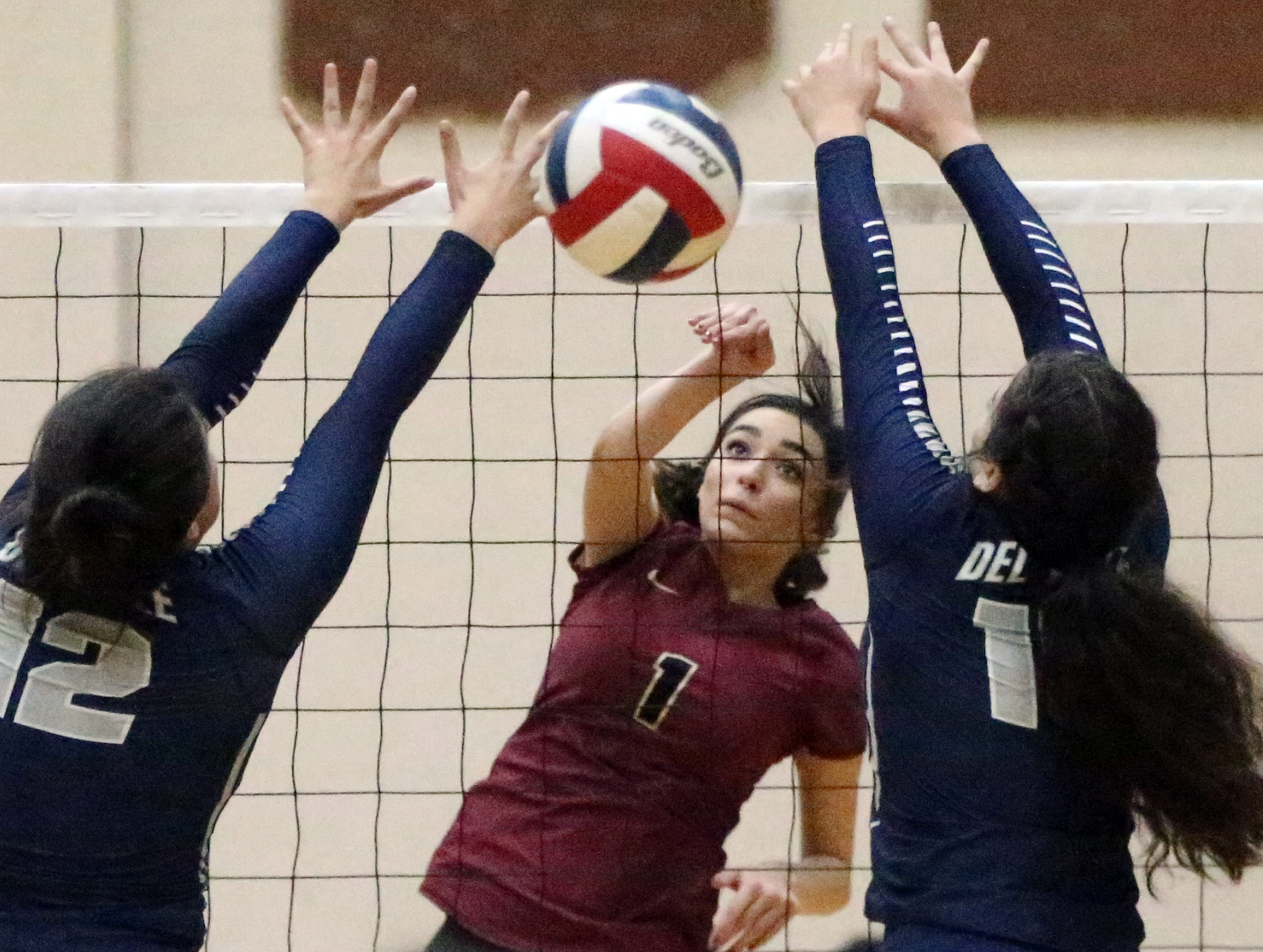 Paig Mcgriff, 1, of El Dorado fires past Del Valle's Madison Valverde, 12, and Natalie Murillo, 15, Tuesday, Sept. 18 at Del Valle. El Dorado won the contest in three sets.