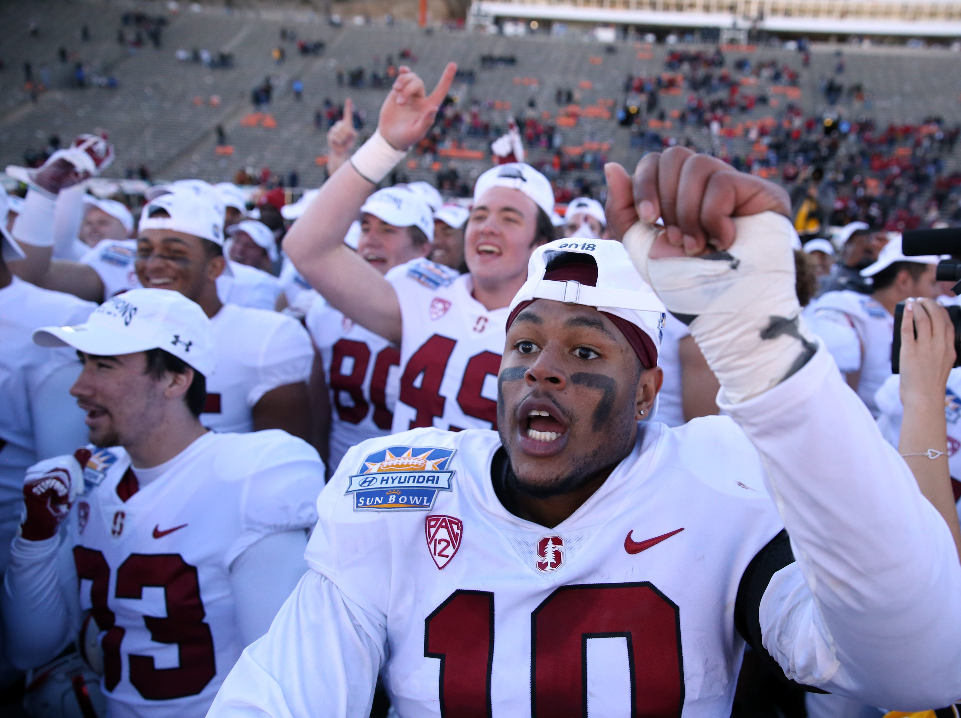 The Stanford Cardinal football team, including outside linebacker Jordan Fox, 10, celebrate their 14-13 win over the University of Pittsburgh Panthers in the 85th Hyundai Sun Bowl game Monday.