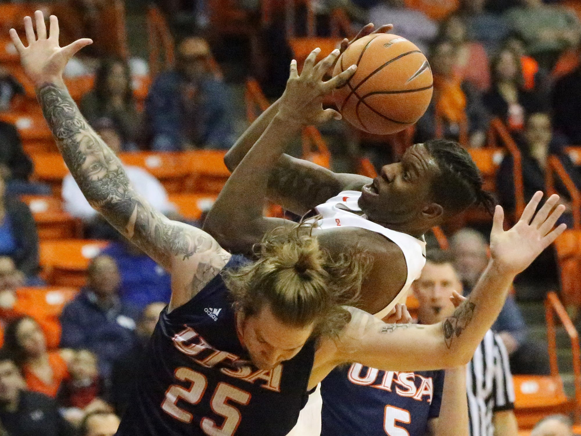 UTEP freshman forward Tirus Smith grabs a rebound while coming down on the back of UTSA's Nick Allen, 25, Saturday night in the Don Haskins Center. Smith was called for a foul followed by a technical foul for saying something to a UTSA player just after the play.