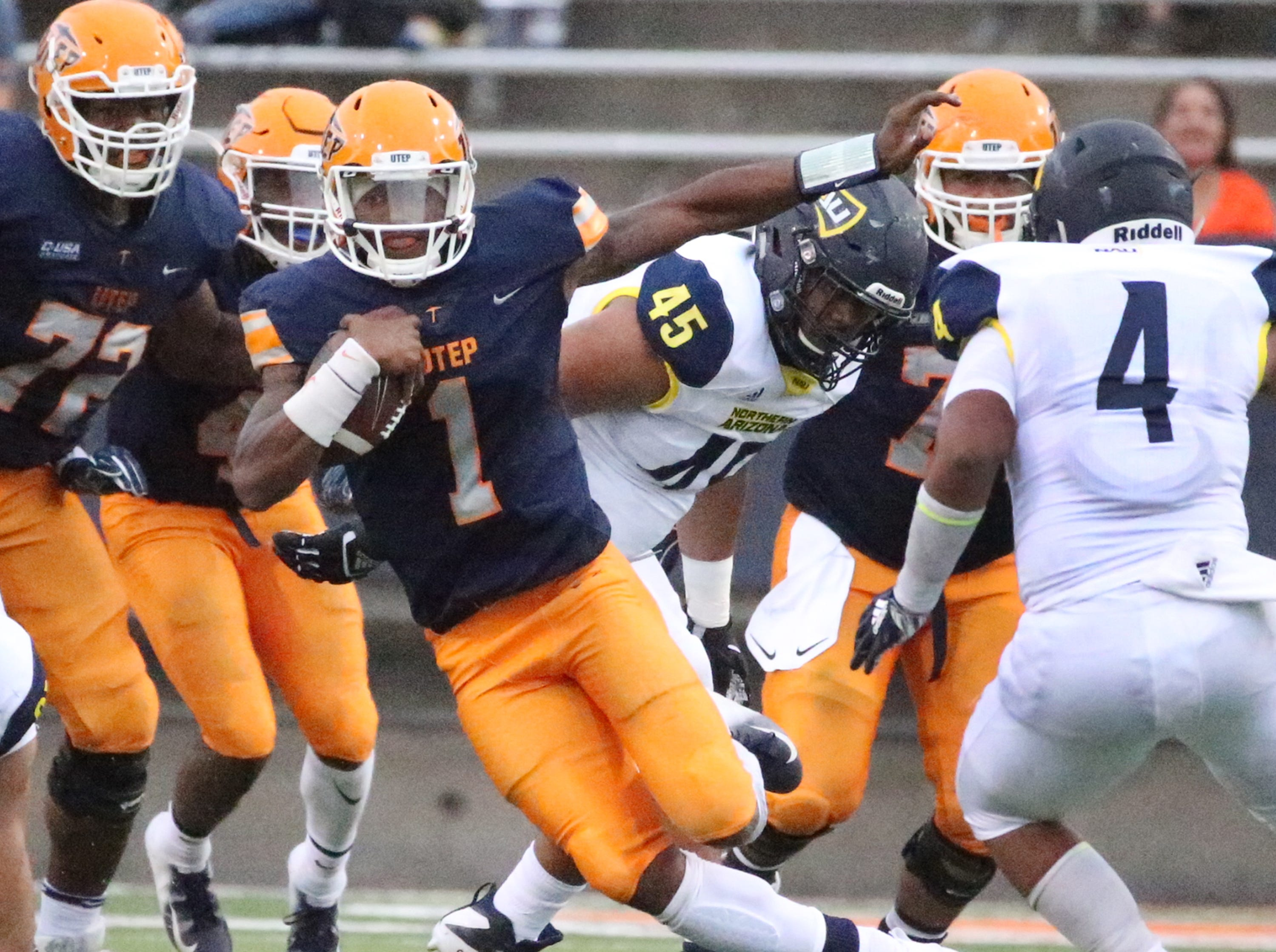 UTEP quarterback Kai Locksley, 1, finds room to run against Northern Arizona Saturday night in the Sun Bowl Stadium.